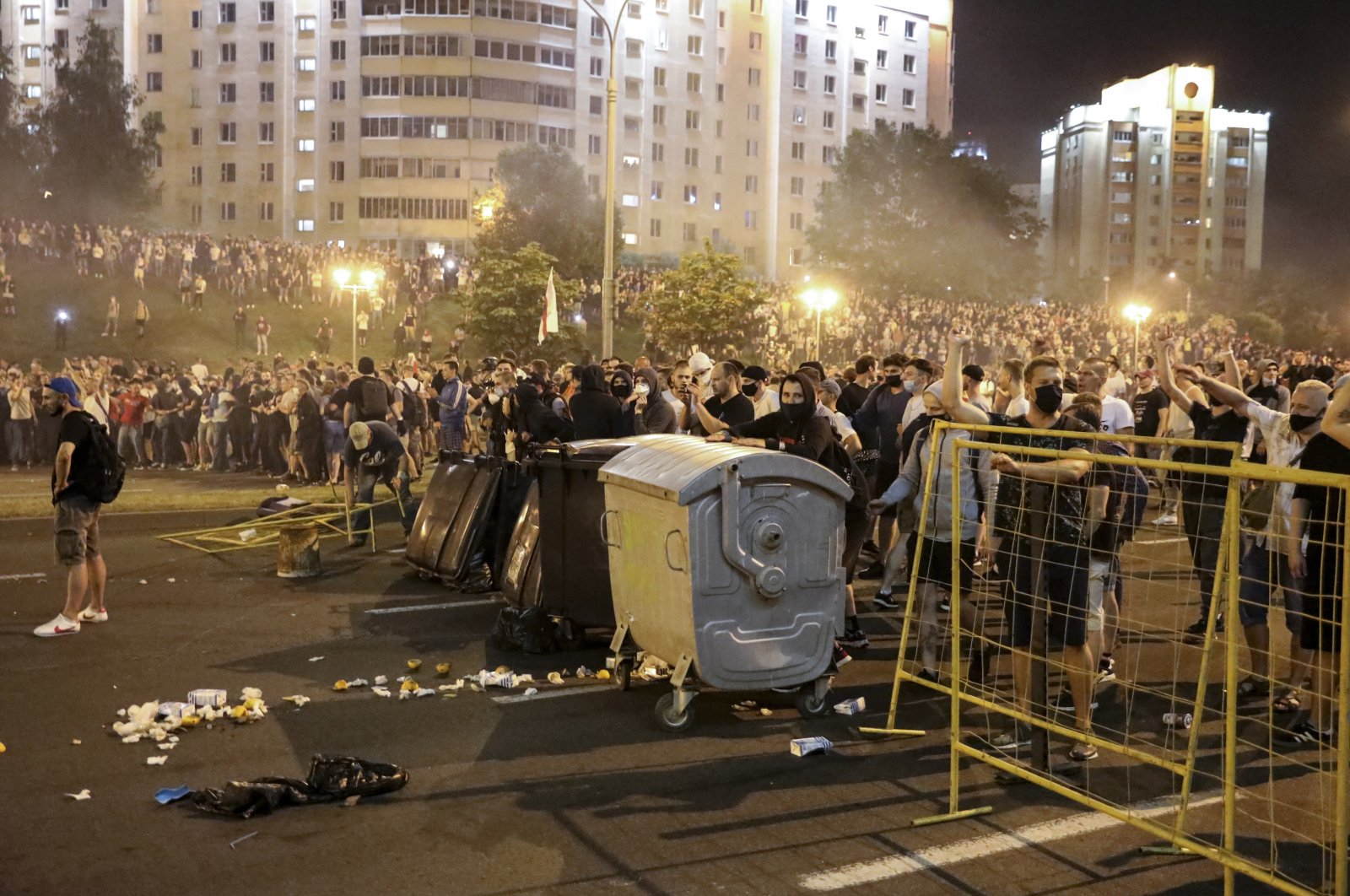 Protesters try to set up a barricade during clashes with police after the Belarusian presidential election in Minsk, Belarus, Aug. 9, 2020. (AP Photo)
