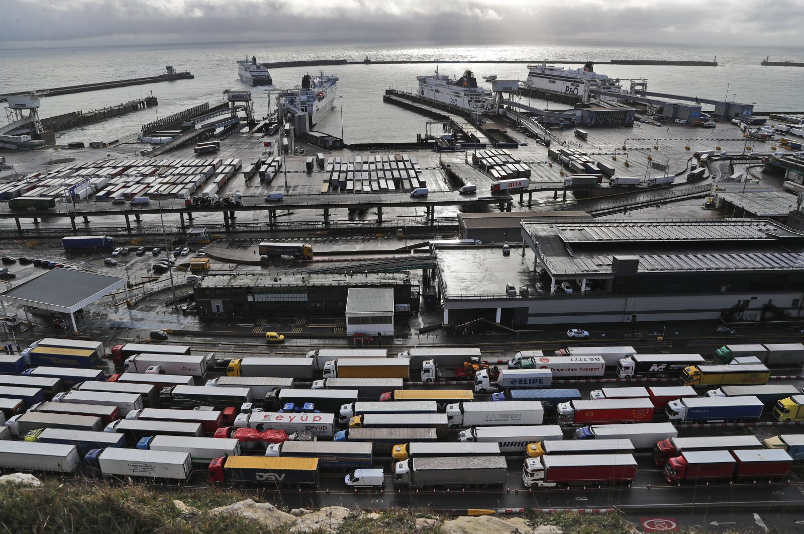 Lorries line up at check-in at the port in Dover, Britain, Dec. 11, 2020. (AP Photo)