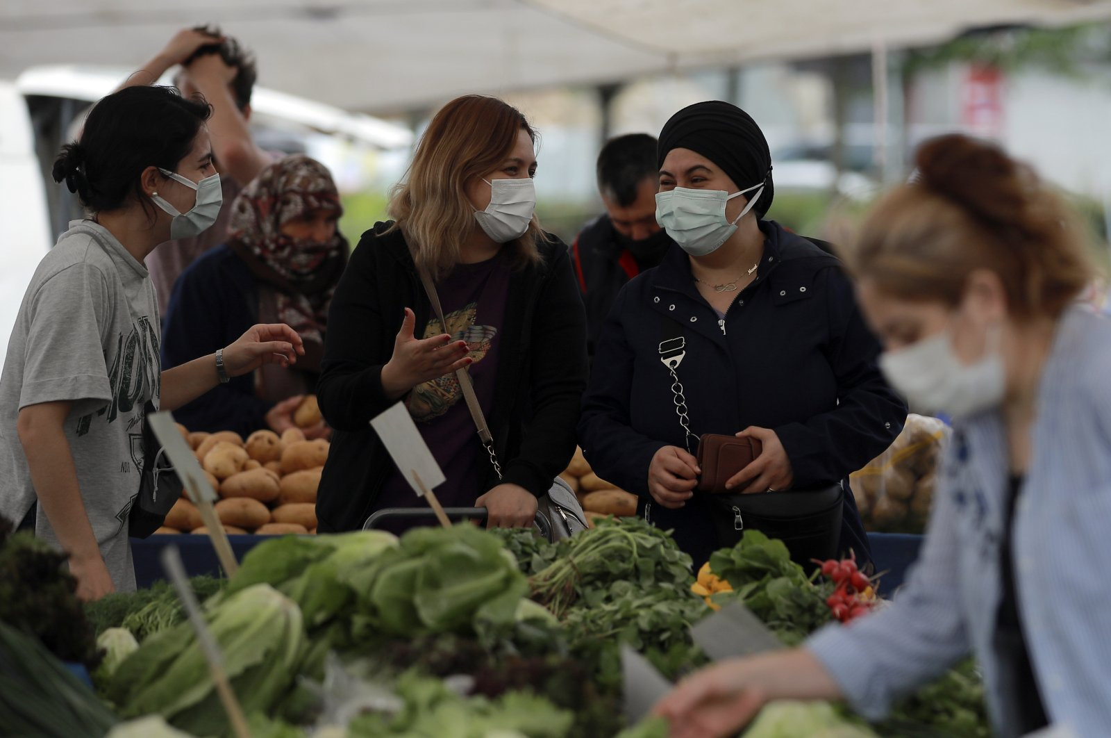 People shop in a market amid the coronavirus outbreak Istanbul, Turkey, May 8, 2021. (AP Photo)