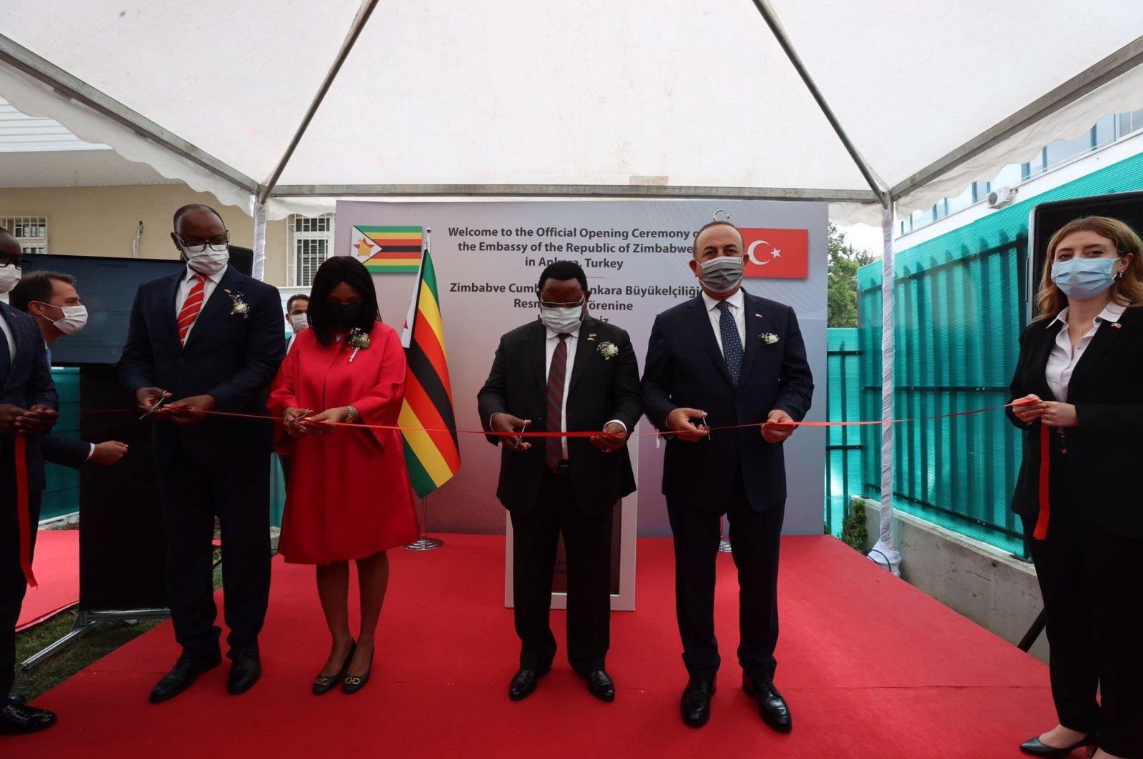 Foreign Minister Mevlüt Çavuşoğlu (R) attends the opening ceremony of the Zimbabwe Embassy in Ankara, Turkey, June 22, 2021. (AA Photo)