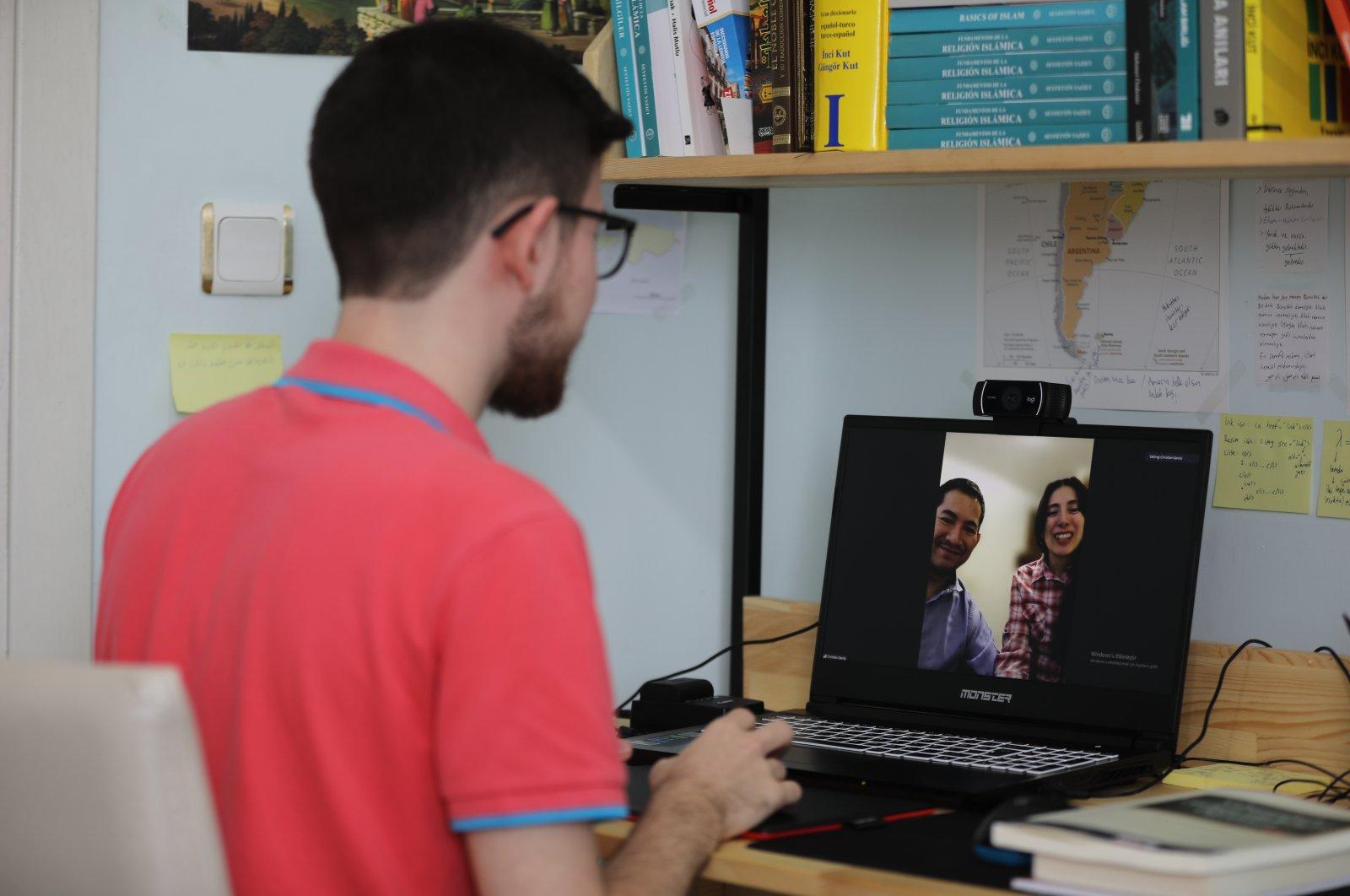 Muhammed Bilal Özyüksel talk to his Spanish-speaking students in an online class, in Istanbul, Turkey, June 22, 2021. (AA PHOTO)