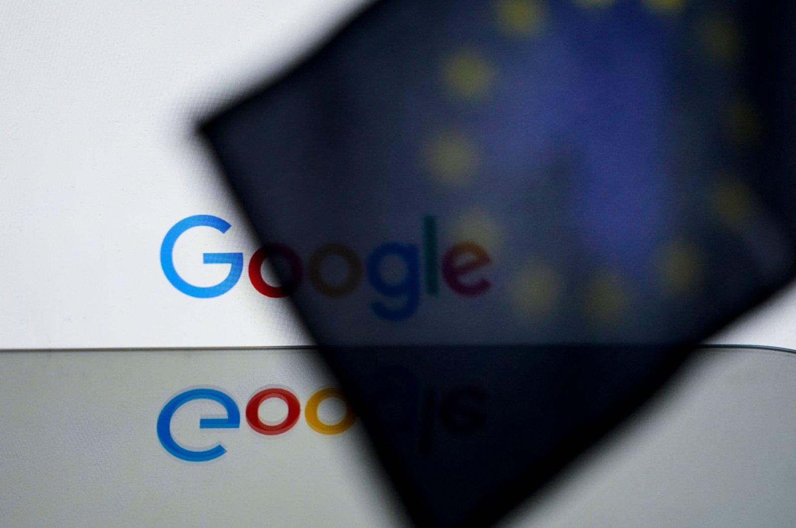 The U.S. multinational tech giant Google logo is seen behind a European flag, in Brussels, Belgium, Feb. 14, 2020. (AFP Photo)