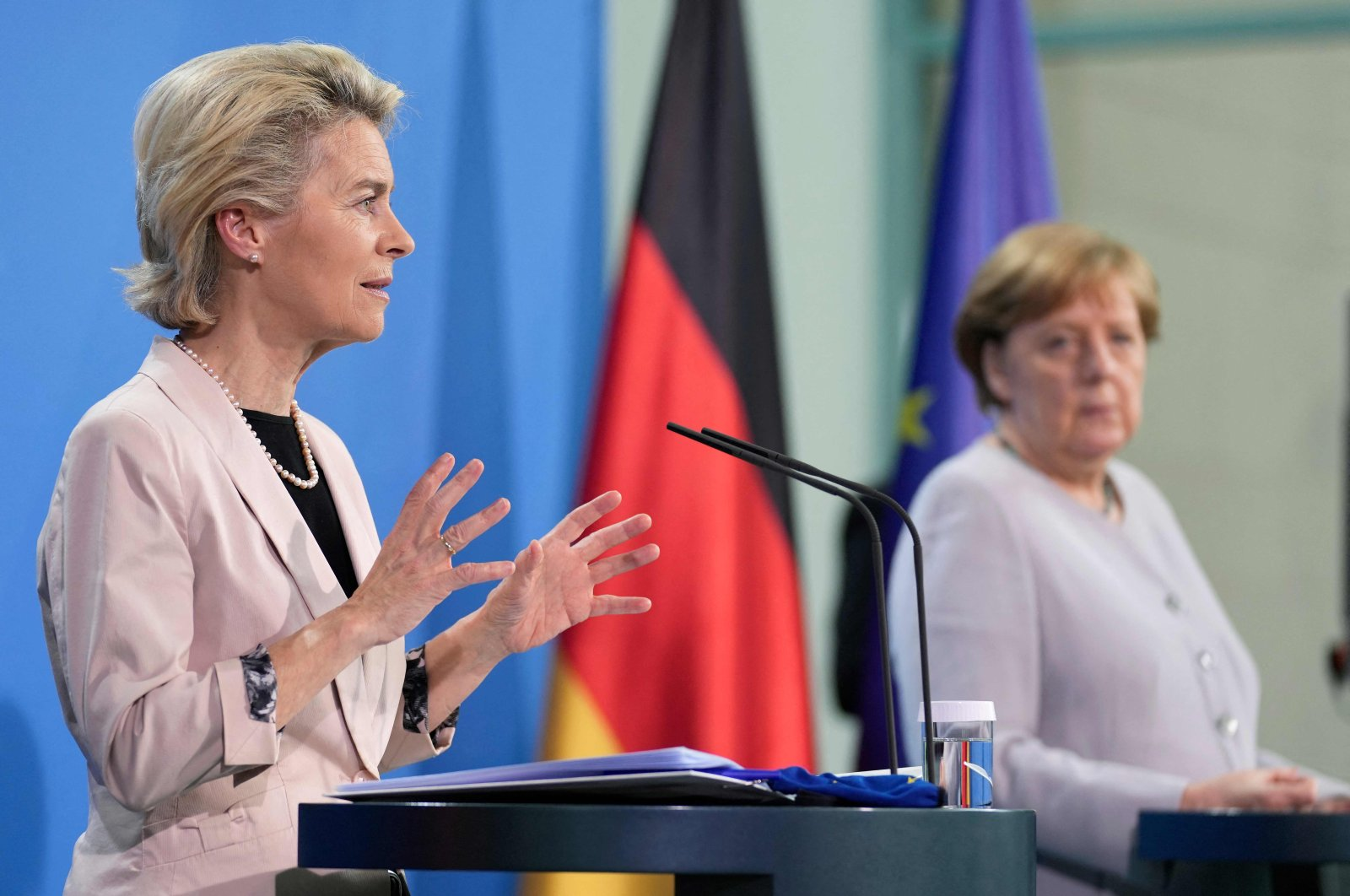 German Chancellor Angela Merkel (R) and European Commission President Ursula von der Leyen address the media during a joint press conference following a meeting in Berlin, Germany, on June 22, 2021. (Photo by Michael Sohn / POOL / AFP)