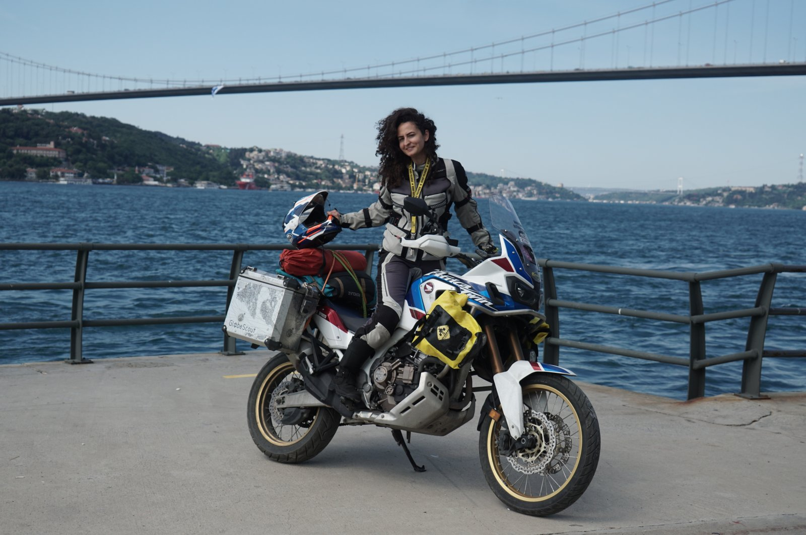 Asil Özbay poses with her motorcycle, in Istanbul, Turkey, June 21, 2021. (AA PHOTO)