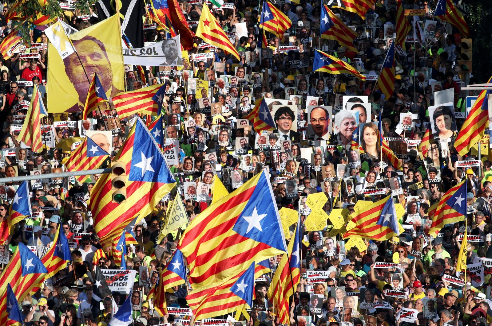 People hold banners during a protest against the imprisonment of the Catalan separatist leaders, in Barcelona, Spain, July 14, 2018. (Reuters Photo)