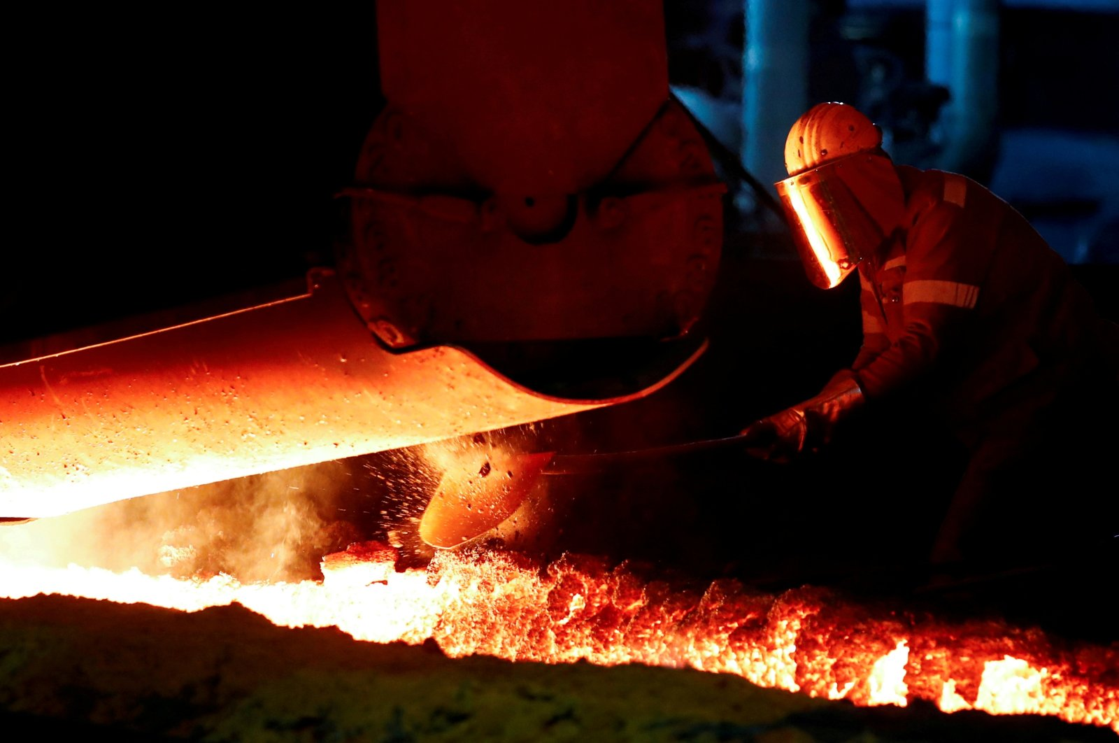 A steel worker of Germany's industrial conglomerate ThyssenKrupp AG works near a blast furnace at Germany's largest steel factory in Duisburg, Germany, Jan. 28, 2019. (Reuters Photo)