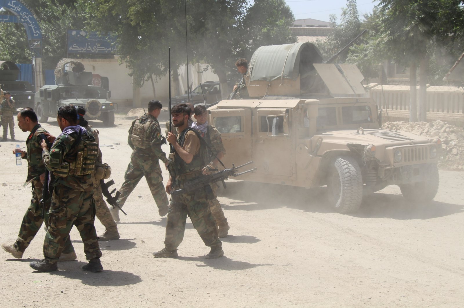Afghan commando forces move about at the site of a battlefield where they clashed with Taliban insurgents, in Kunduz province, Afghanistan, June 22, 2021. (Reuters Photo)