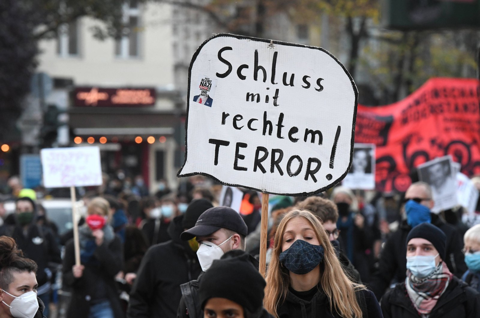 """A rally against neo-Nazis where a woman holds a sign reading """"end to right terror,"""" Berlin, Germany, Nov. 7, 2020. (Reuters Photo)"""
