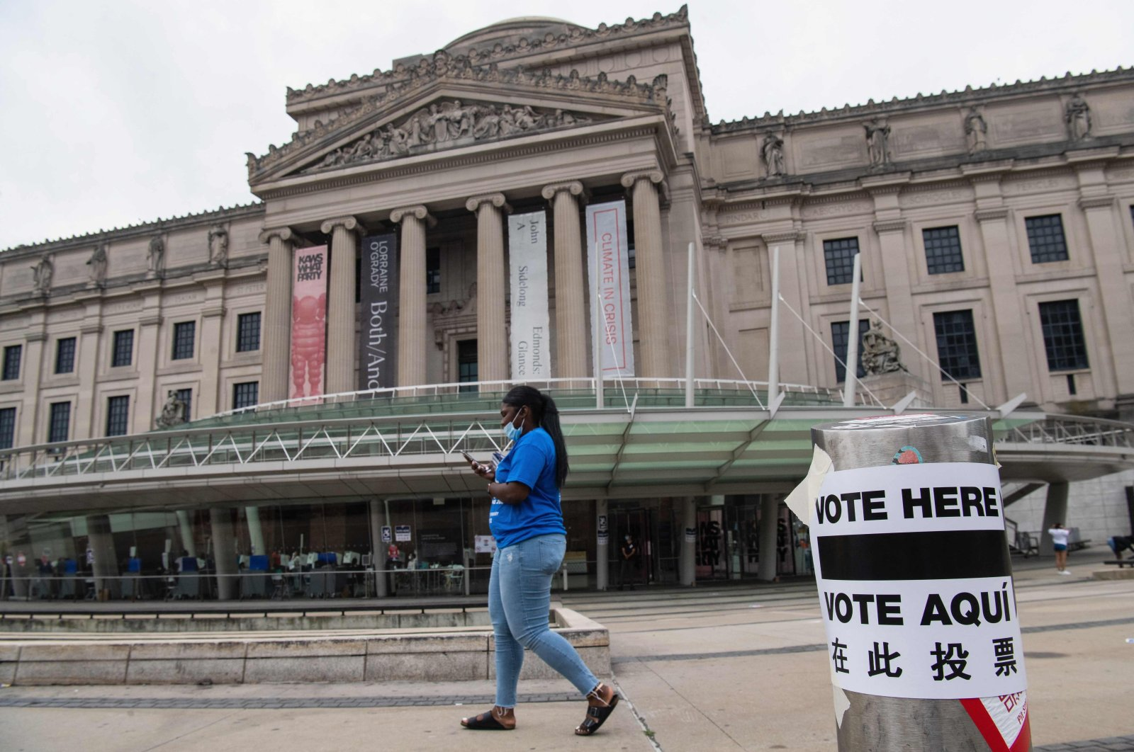 A woman walks past the Brooklyn Museum polling station as residents vote in the Democratic mayoral primary election, New York City, United States, June 22, 2021. (AFP Photo)