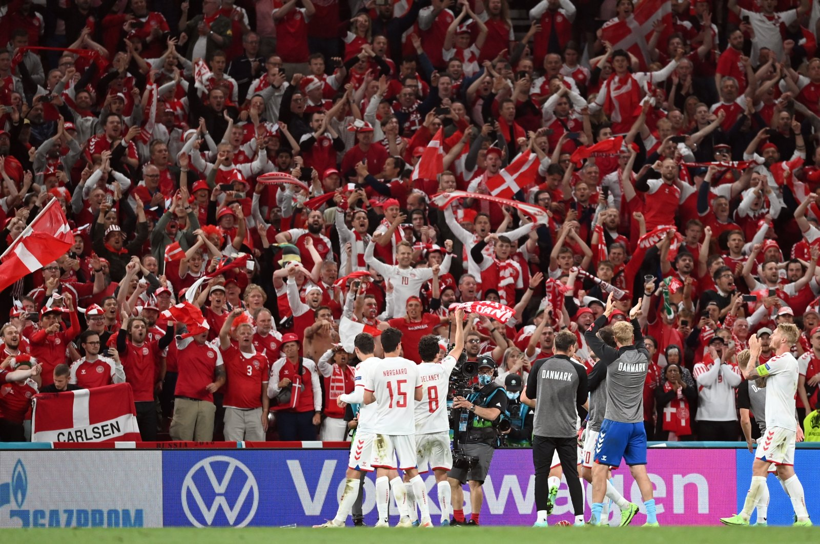 Players of Denmark celebrate with fans after winning the UEFA EURO 2020 group B preliminary round soccer match between Russia and Denmark in Copenhagen, Denmark, June 21, 2021. (EPA Photo)