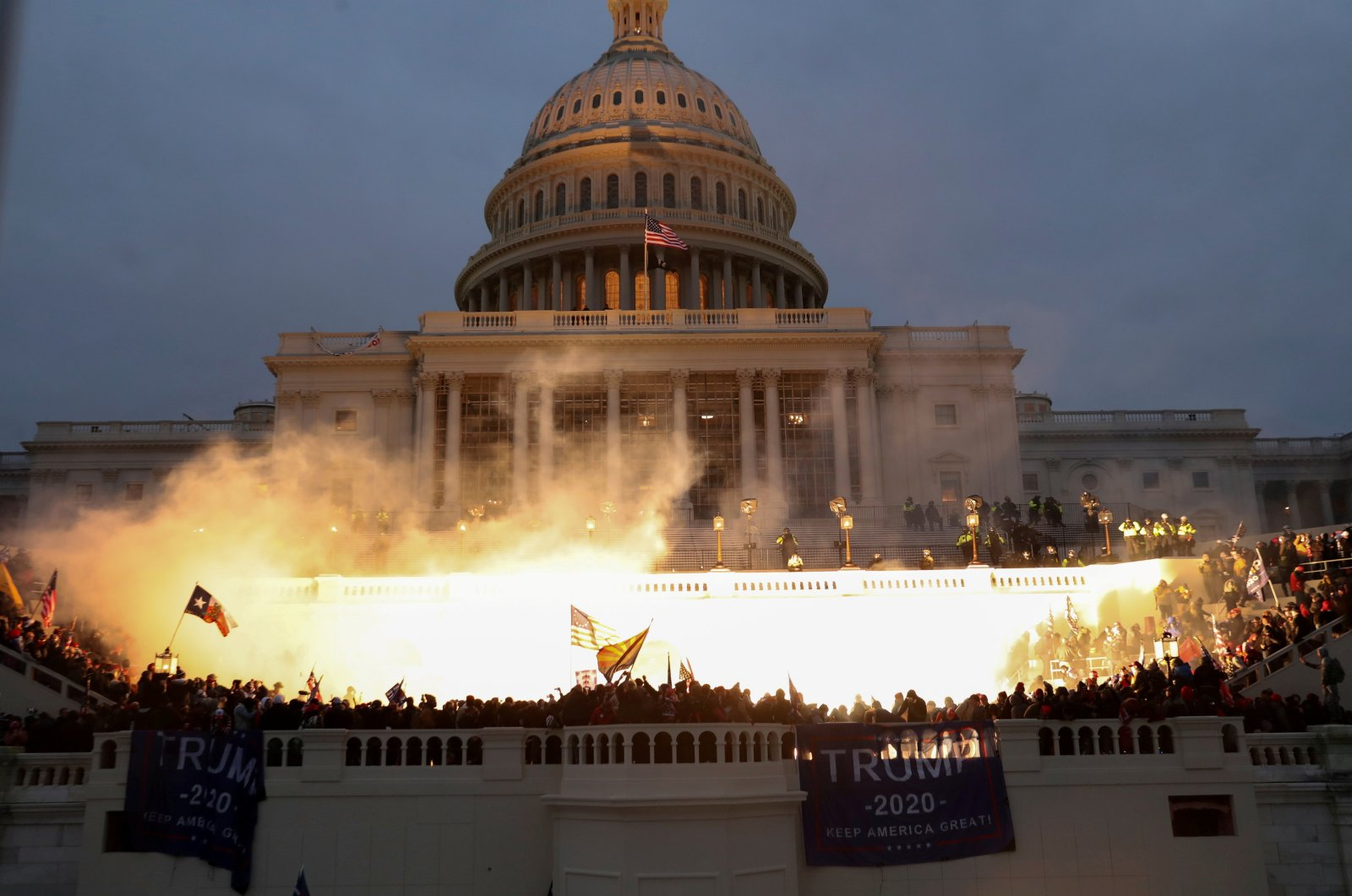 An explosion caused by a police munition is seen while supporters of U.S. President Donald Trump gather in front of the U.S. Capitol Building in Washington, U.S., Jan. 6, 2021. (Reuters Photo)