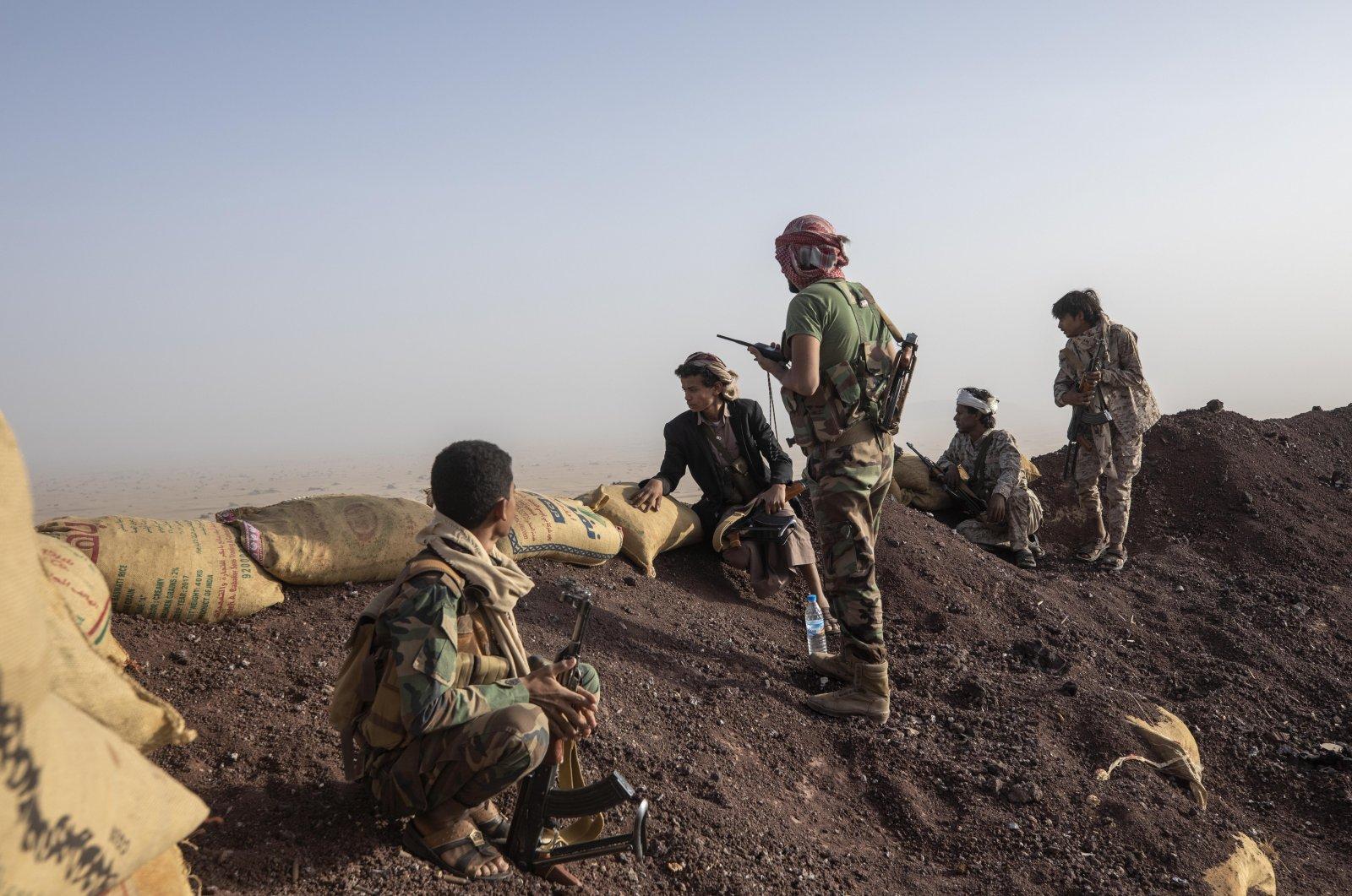 Yemeni fighters backed by the Saudi-led coalition on the Kassara frontline near Marib, Yemen, June 20, 2021. (AP Photo)