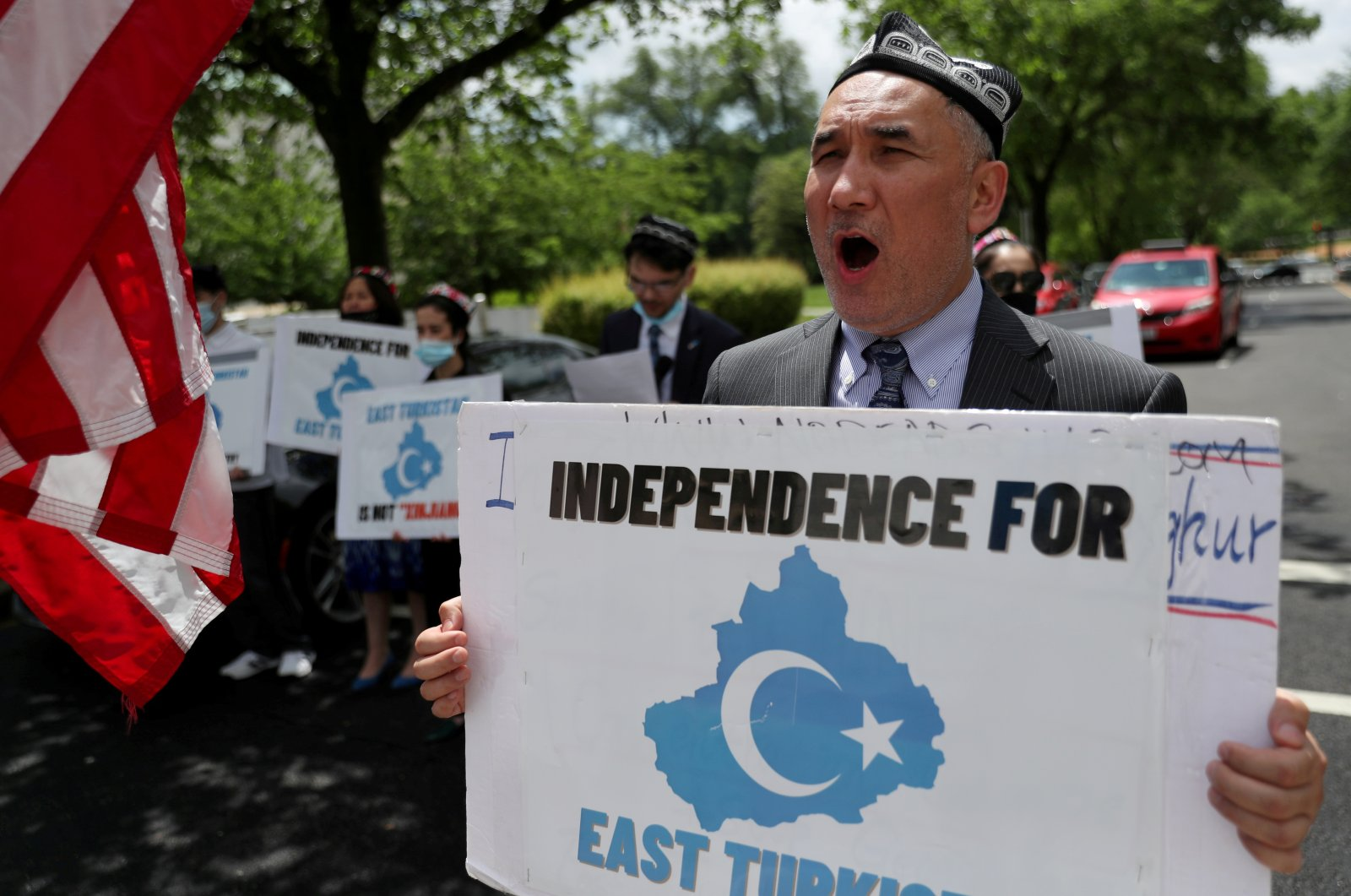 Demonstrators hold a protest in front of the U.S. State Department to commemorate Uyghur Doppa Day and to urge the U.S. and the international community to take action against China's treatment of the Uyghur people in Xinjiang, in Washington, U.S., May 5, 2021. (Reuters Photo)