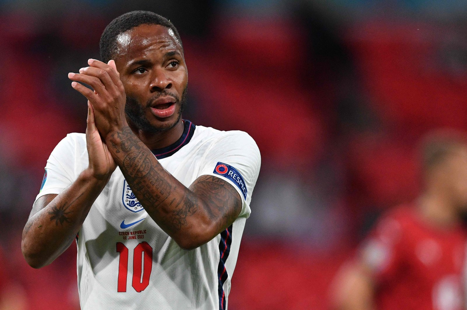 England's forward Raheem Sterling applauds as he comes off during the UEFA EURO 2020 Group D football match between Czech Republic and England at Wembley Stadium in London on June 22, 2021. (AFP Photo)