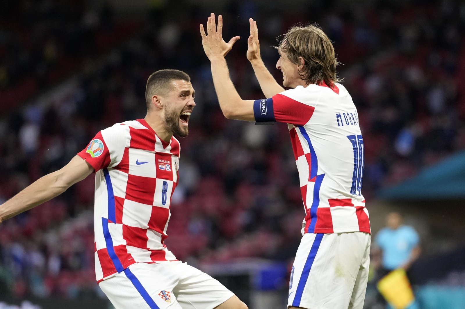 Croatia's Mateo Kovacic (L) and Luka Modric celebrate after Ivan Perisic scored their third goal during the Euro 2020 Group D match against Scotland at the Hampden Park Stadium, Glasgow, Scotland, June 22, 2021. (AP Photo)
