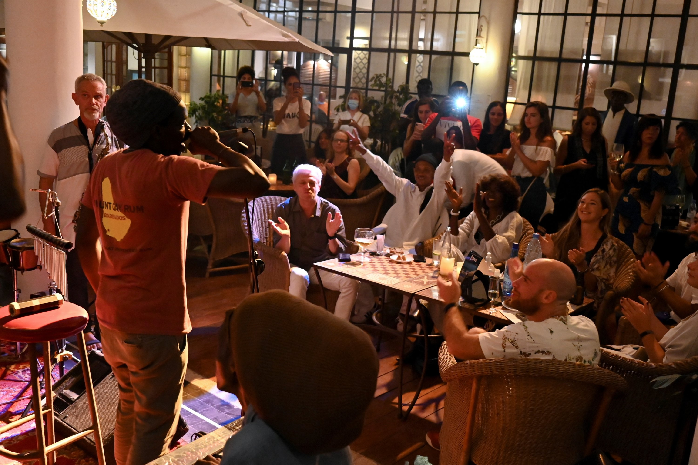 Percussionist Malek Val addresses the crowd at the Hotel De La Residence during the Saint Louis Jazz Festival in Saint Louis, Senegal, June 19, 2021 (Reuters Photo)