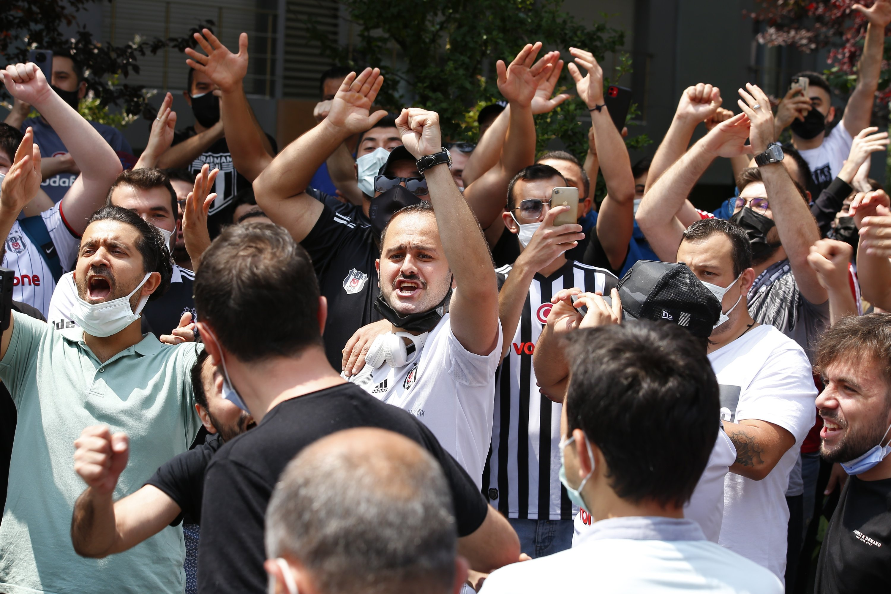 A group of Beşiktaş fans gathers in front of Sergen Yalçın's house to show their support and persuade him to stay at the club, June 22, 2021. (IHA Photo)