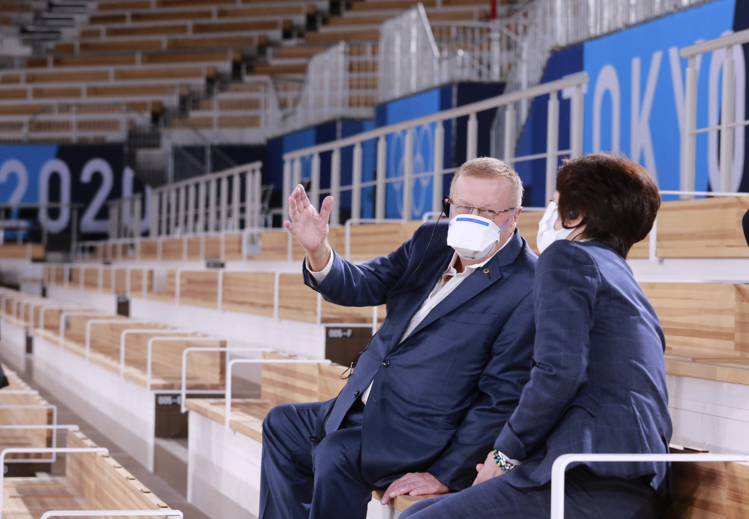 International Olympic Committee (IOC) Vice President John Coates (L) talks with Tokyo 2020 Olympics Organizing Committee President Seiko Hashimoto during their inspection at Ariake Gymnastics Center in Tokyo, Japan, June 23, 2021. (AP Photo)