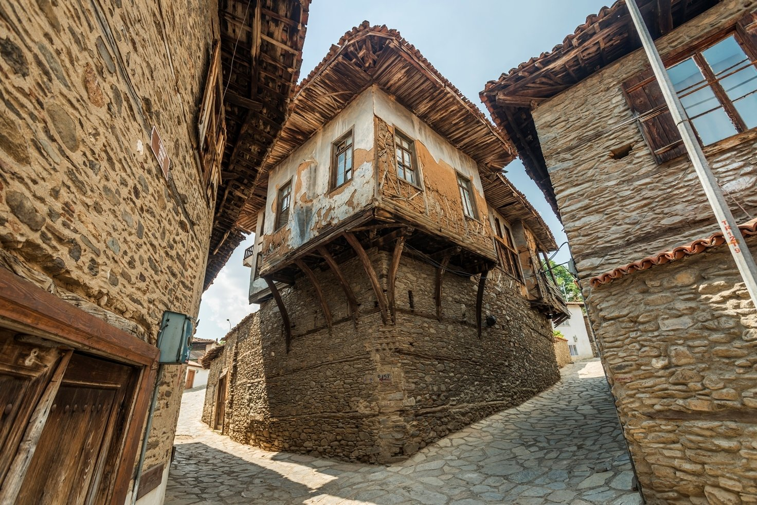 The houses built with natural stones and wood are the standouts of Birgi.