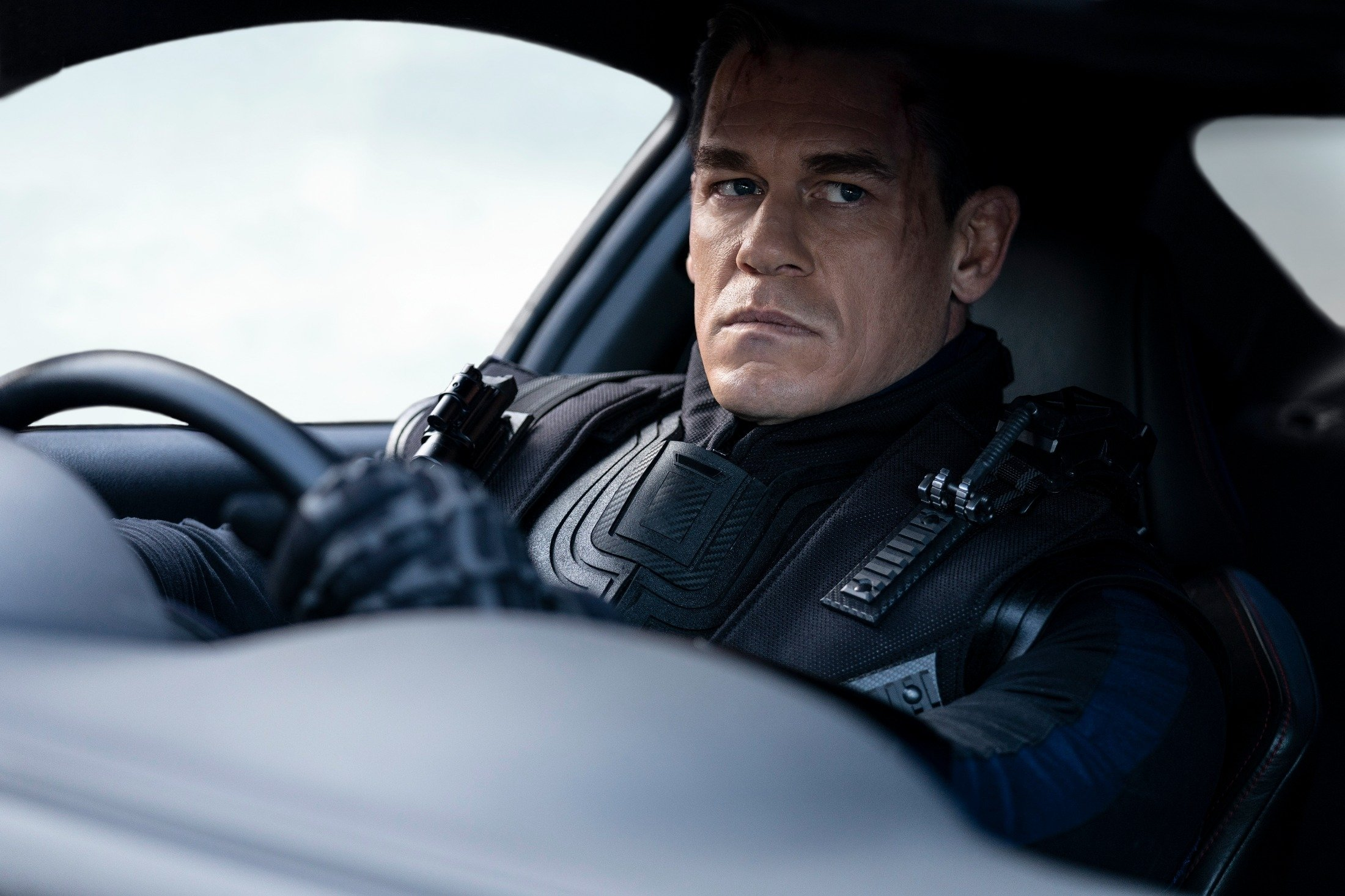 John Cena looks menacingly off camera as he drives in a scene from the movie'F9: The Fast Saga.' (Universal Pictures via AP)