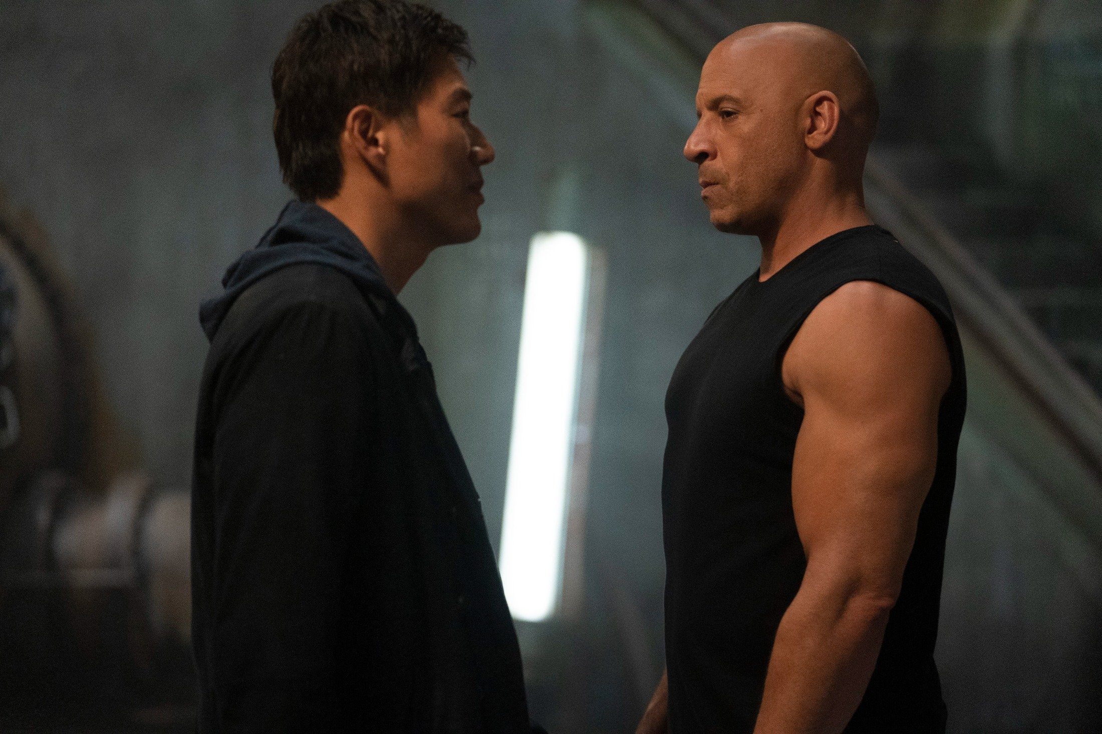 Sung Kang (L), and Vin Diesel face off in a scene from the movie'F9: The Fast Saga.' (Universal Pictures via AP)