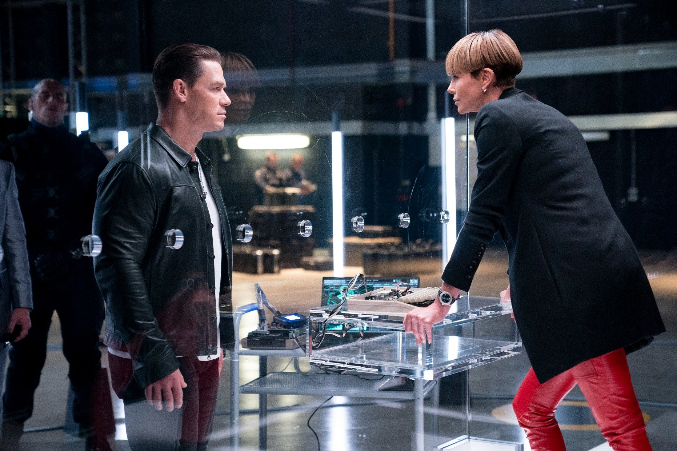 John Cena (L) and Charlize Theron have a conversation, in a scene from the movie'F9: The Fast Saga.' (Universal Pictures via AP)
