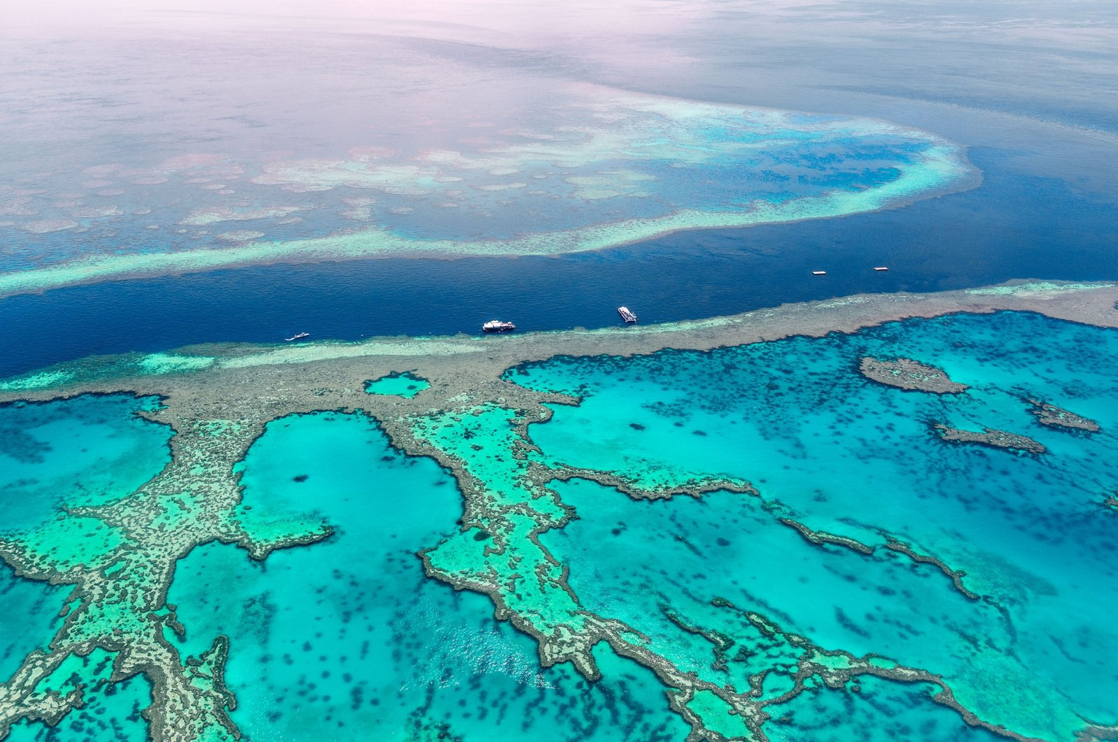 Boats float at the Great Barrier Reef. (Shutterstock Photo)