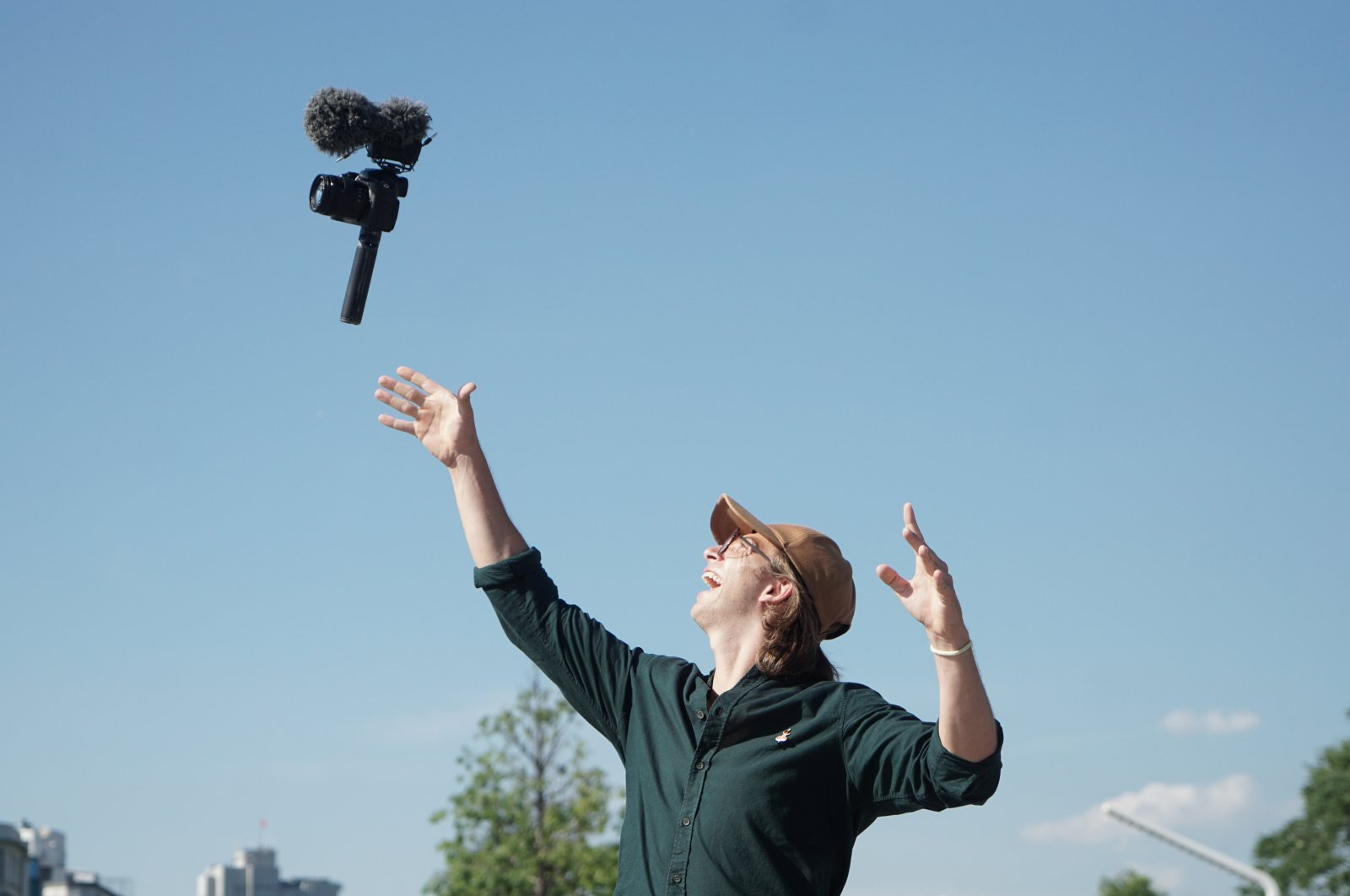 Franco Dubini poses throwing his camera in Istanbul, Turkey, June 20, 2021. (AA Photo)