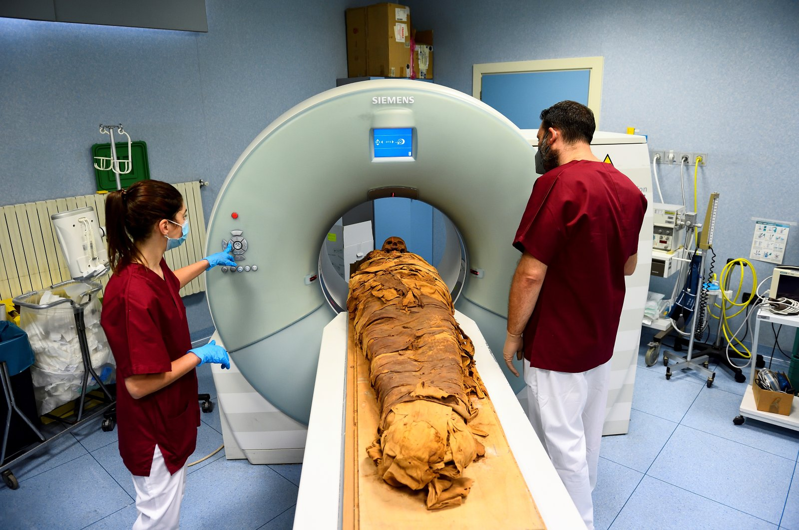 Medical radiology technicians prepare a CT scan to do a radiological examination of an Egyptian mummy in order to investigate its history at the Policlinico hospital in Milan, Italy, June 21, 2021. (Reuters Photo)