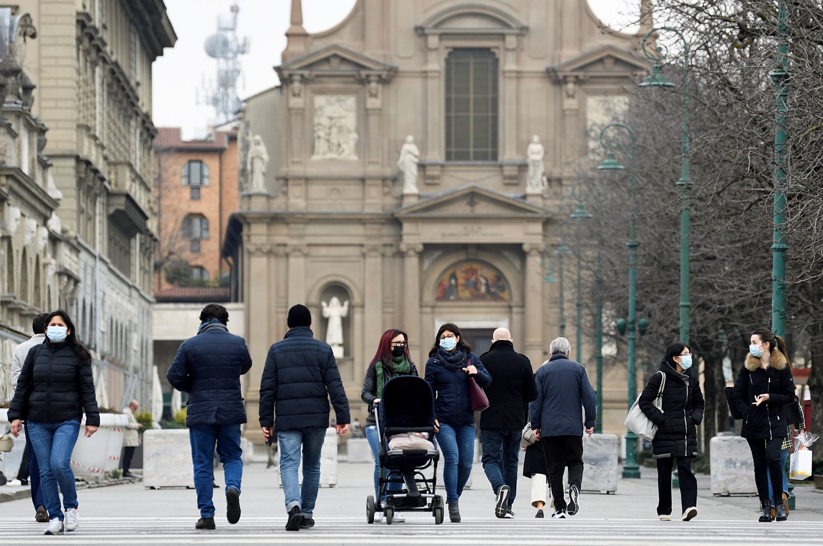 People walk on a street a year after the peak of Italy's coronavirus outbreak, in Bergamo, the country's epicenter, Italy, March 3, 2021. (Reuters Photo)