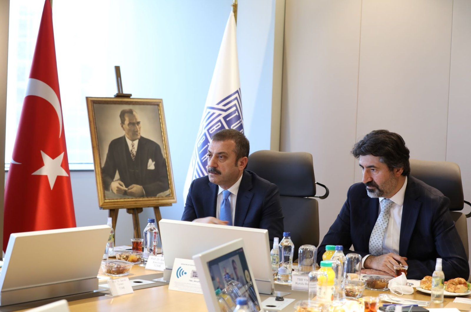 Central Bank of the Republic of Turkey (CBRT) Governor Şahap Kavcıoğlu (L) listens to senior bankers during a meeting in Istanbul, Turkey, June 22, 2021. (TBB via AA)