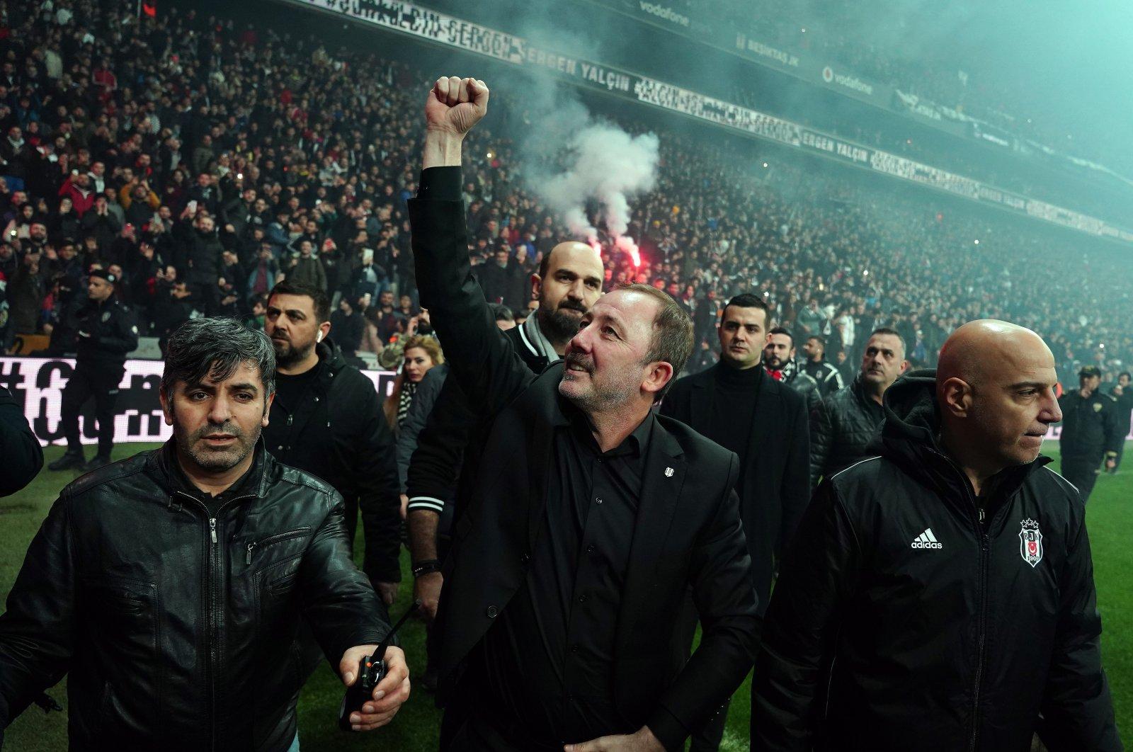 Beşiktaş manager Sergen Yalçın (C) reacts to the fans celebrating the club's domestic double at theVodafone Park,Beşiktaş, Istanbul, May 19, 2021. (IHA Photo)