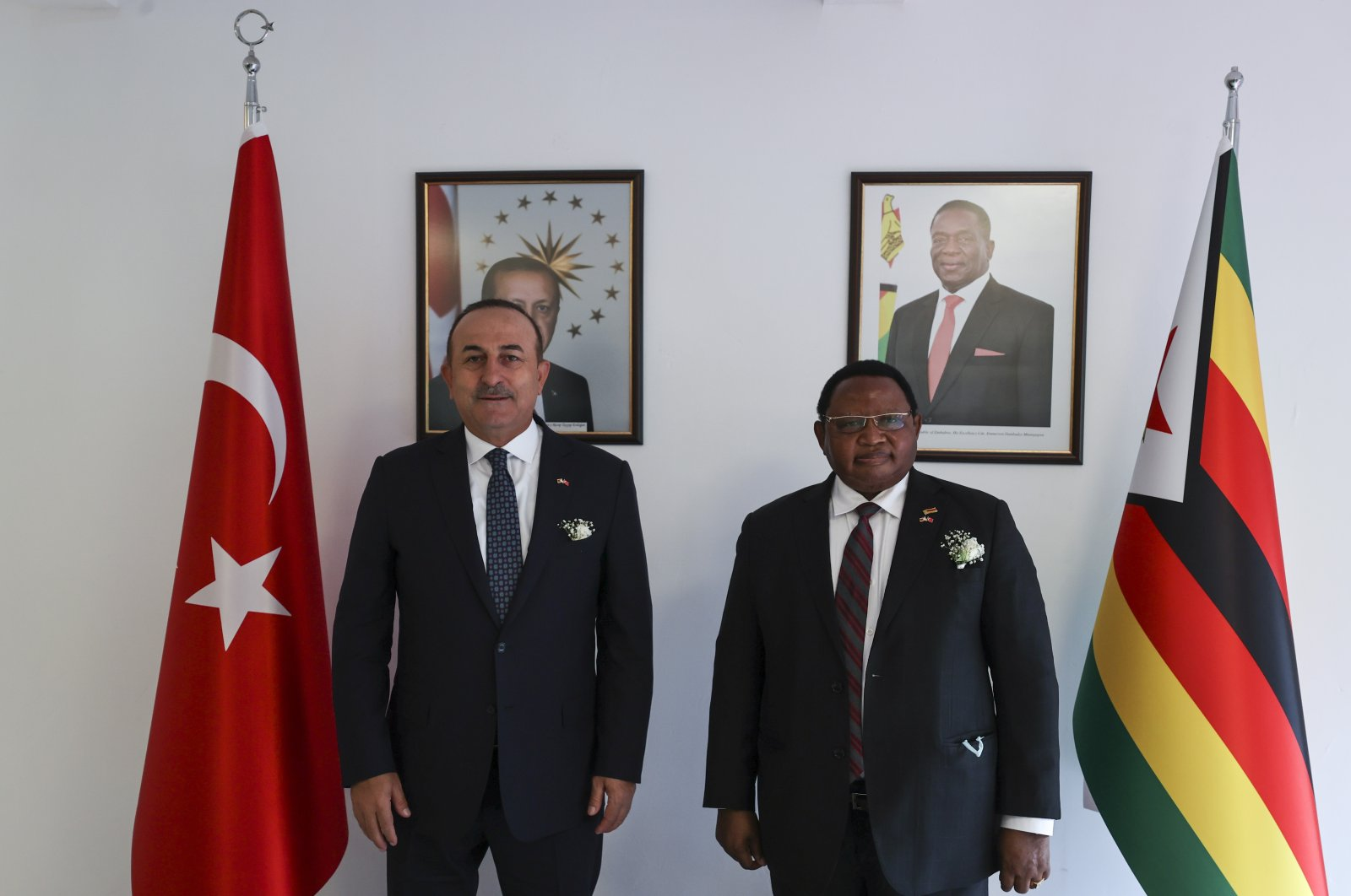 Turkish Foreign Minister Mevlüt Çavuşoğlu poses with his Zimbabwean counterpart Frederick Shava at the opening ceremony of Zimbabwe's Embassy in Ankara, Turkey, June 13, 2021. (AA Photo)