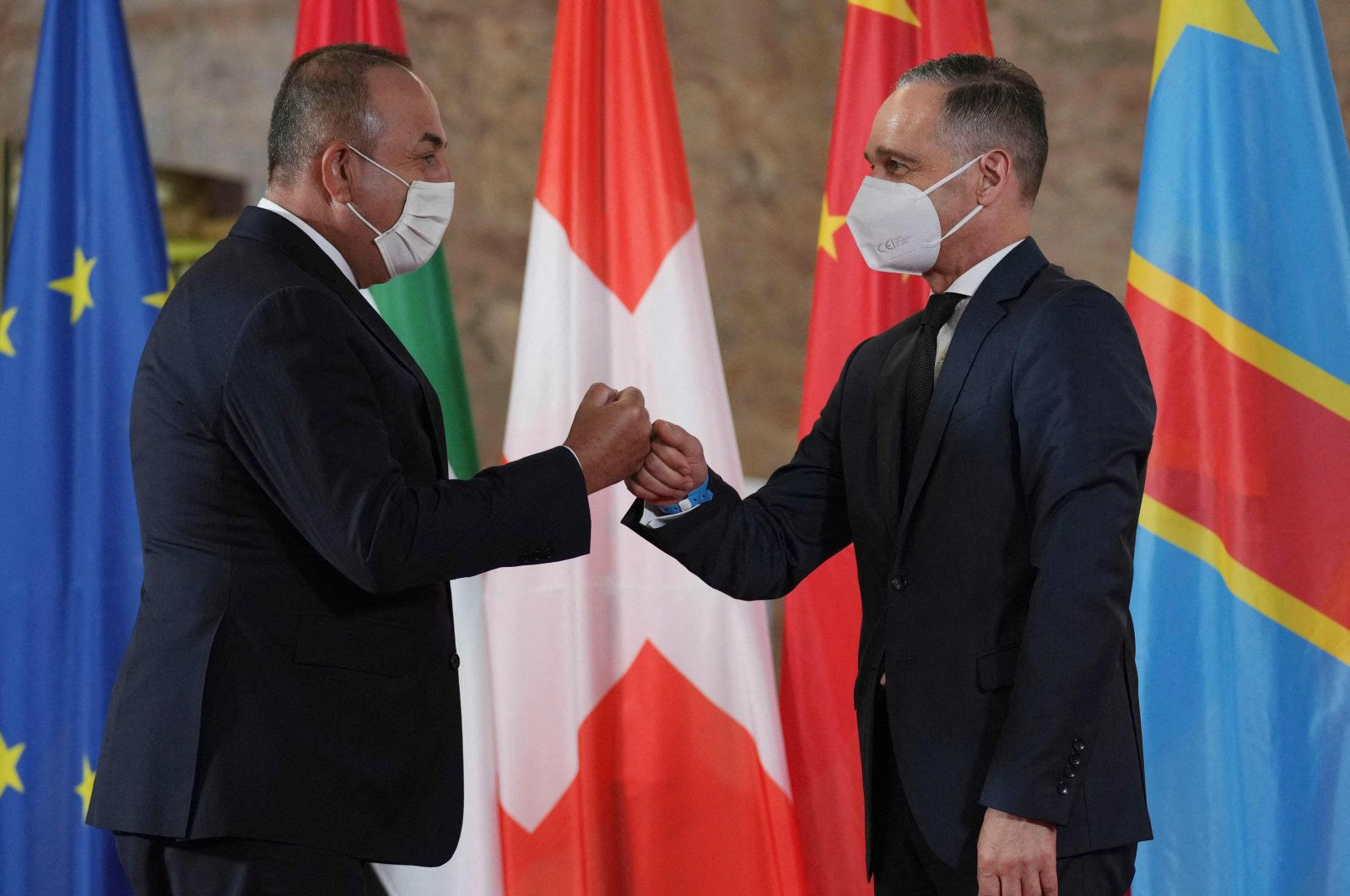 German Foreign Minister Heiko Maas (R) welcomes Turkish Foreign minister Mevlüt Çavuşoğlu for the Second Berlin Conference on peace in Libya at the German Foreign Ministry in Berlin on June 23, 2021. (AFP Photo)