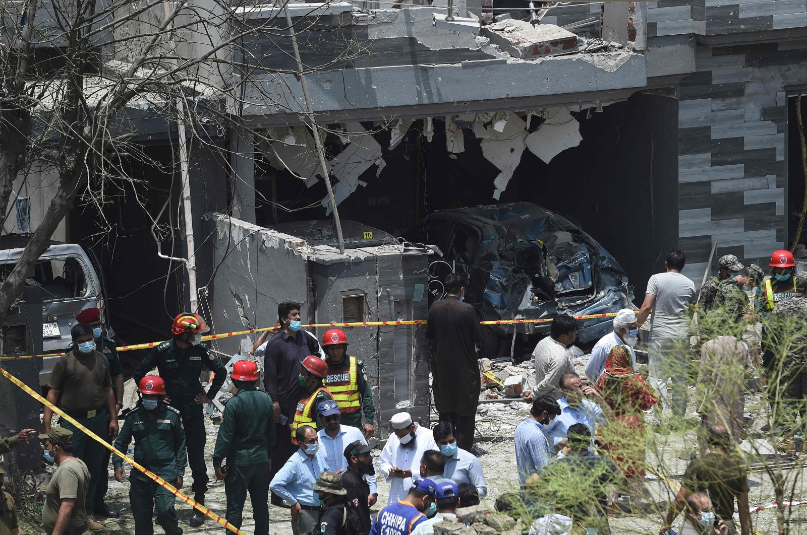 Security officials inspect the site of an explosion that killed at least three people and wounded several others in the city of Lahore, eastern Pakistan, June 23, 2021. (AFP Photo)