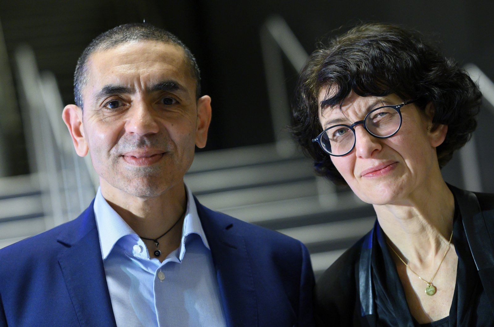 Uğur Şahin (L) and Özlem Türeci pose for a photo at an award ceremony, in Berlin, Germany, March 18, 2021. (AP PHOTO)