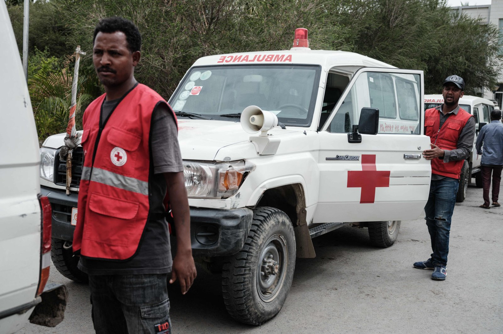 Relatives of Togoga residents, a village about 20km west of Mekele, where an alleged airstrike hit a market leaving an unknown number of casualties, wait for information as Red Cross ambulances are standing by after being denied access to the site, at the Ayder referral hospital in Mekele, Ethiopia, June 23, 2021. (AFP Photo)