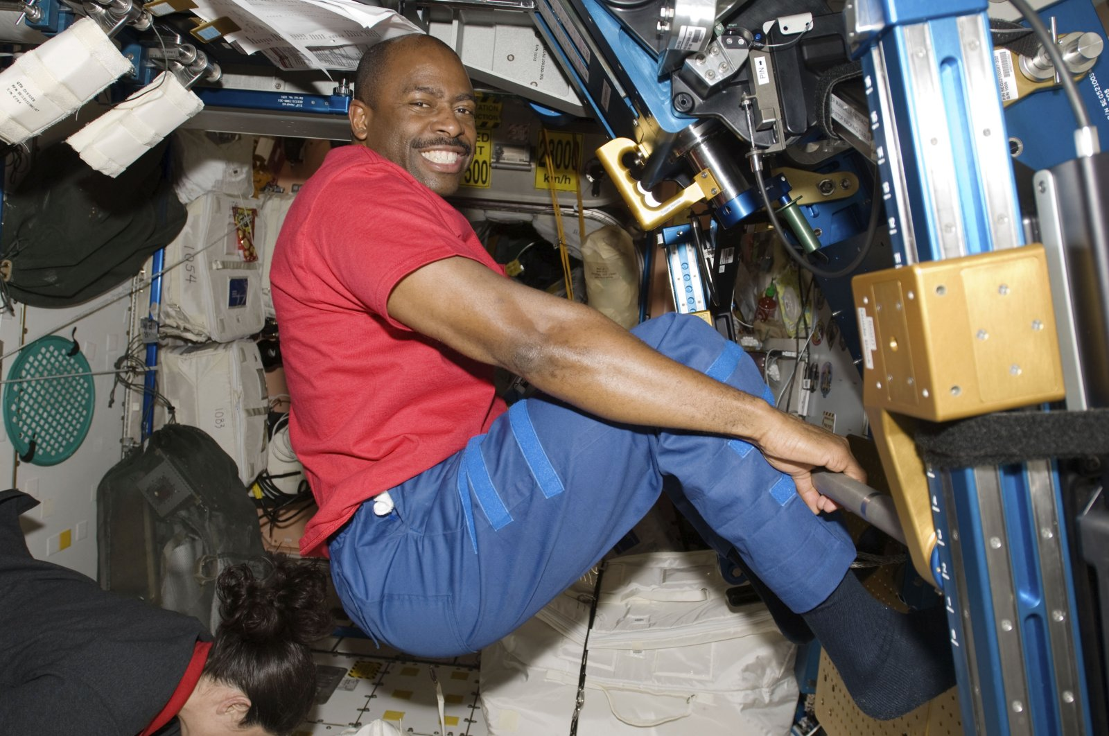Astronaut Leland Melvin, STS-129 mission specialist, exercises in the Unity module of the International Space Station while the space shuttle Atlantis is docked with the station, Nov. 22, 2009. (NASA via AP)