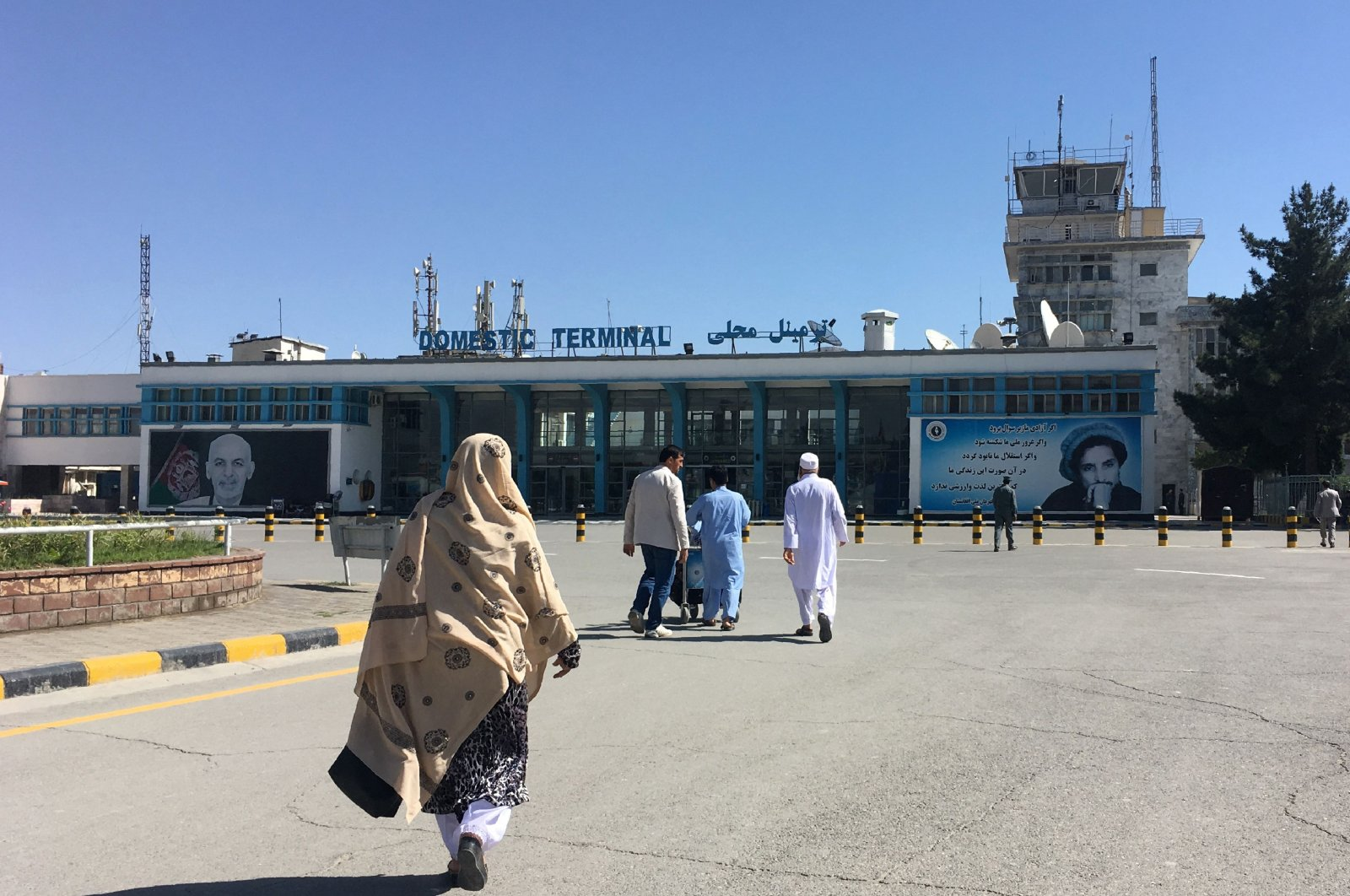 People arrive at the domestic terminal of the Hamid Karzai International Airport in Kabul, Afghanistan, May 8, 2018. (AFP Photo)