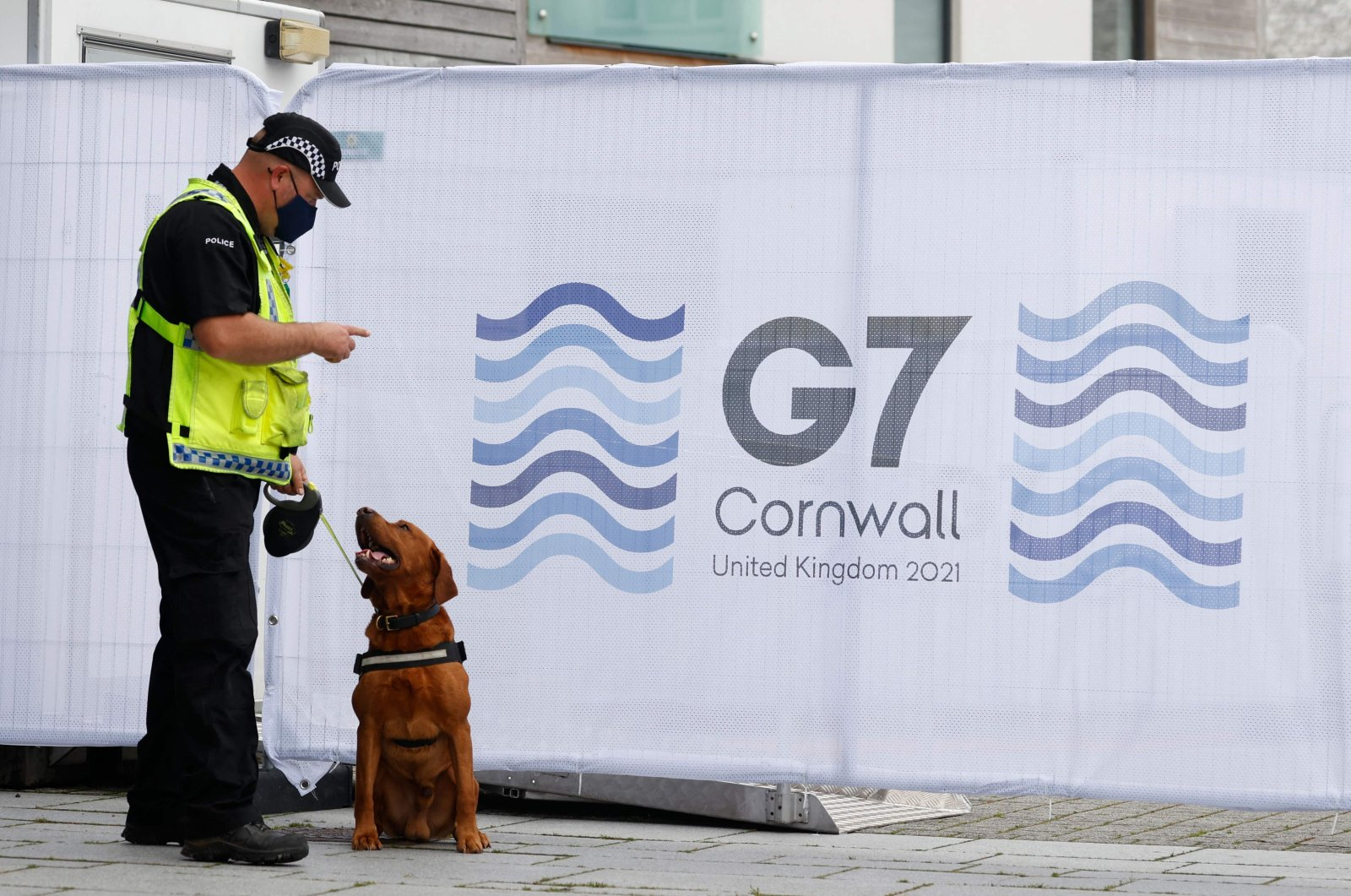 A police sniffer dog patrols the G-7 media center in Falmouth, Cornwall, U.K., on June 10, 2021, (AFP Photo)