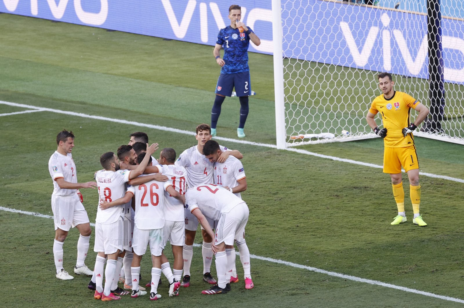 Spain players celebrate after Slovakia's Juraj Kucka scored an own-goal, Spain's fifth during the Euro 2020 football championship Group E match between Slovakia and Spain at La Cartuja Stadium in Seville, Spain, June. 23, 2021. (Pool Photo via AP)