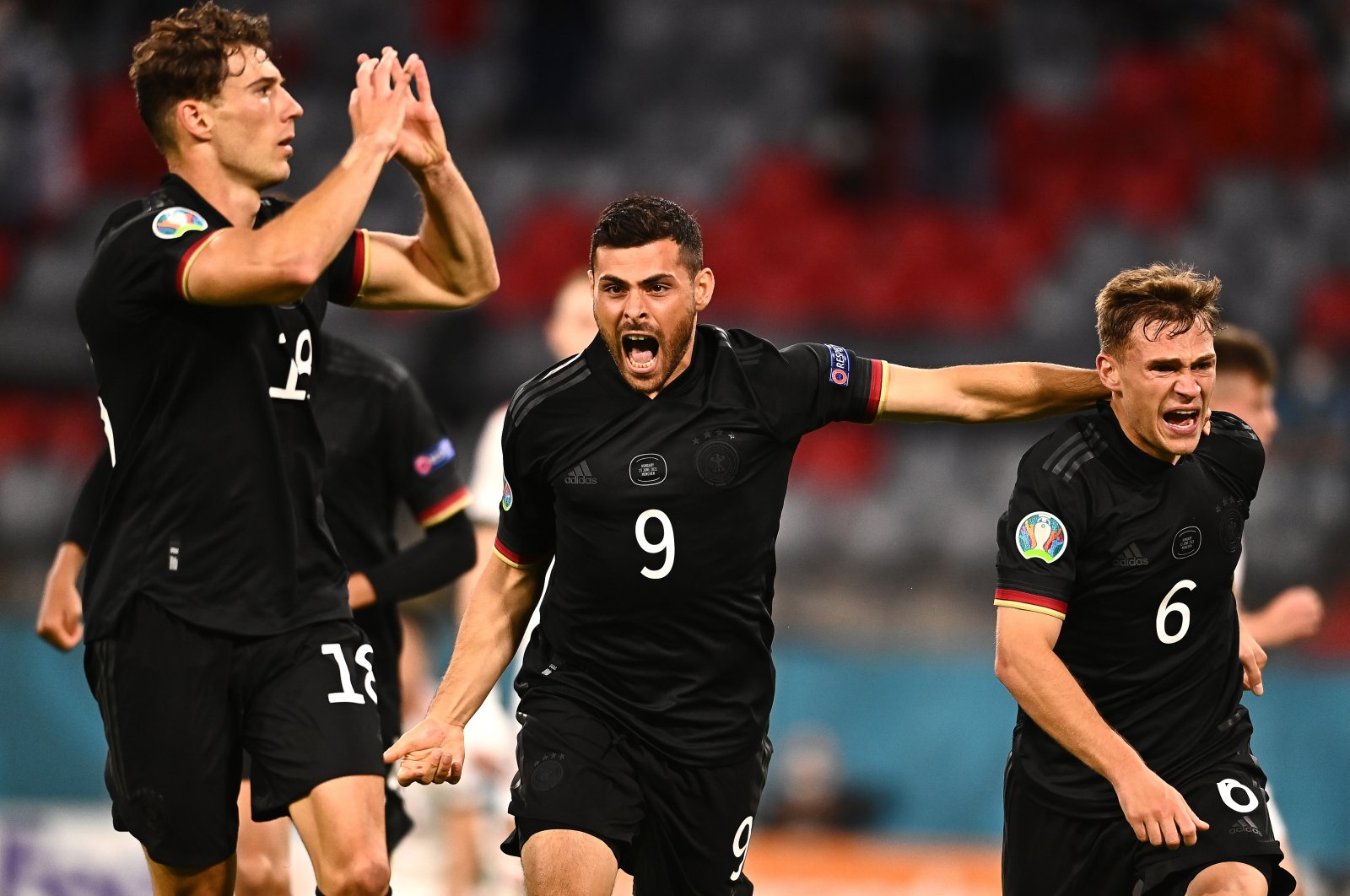 Leon Goretzka (L) of Germany celebrates with teammates Kevin Volland (C) and Joshua Kimmich (R) after scoring the 2-2 equalizer during the UEFA Euro 2020 Group F preliminary round soccer match between Germany and Hungary in Munich, Germany, June 23, 2021. (EPA Photo)