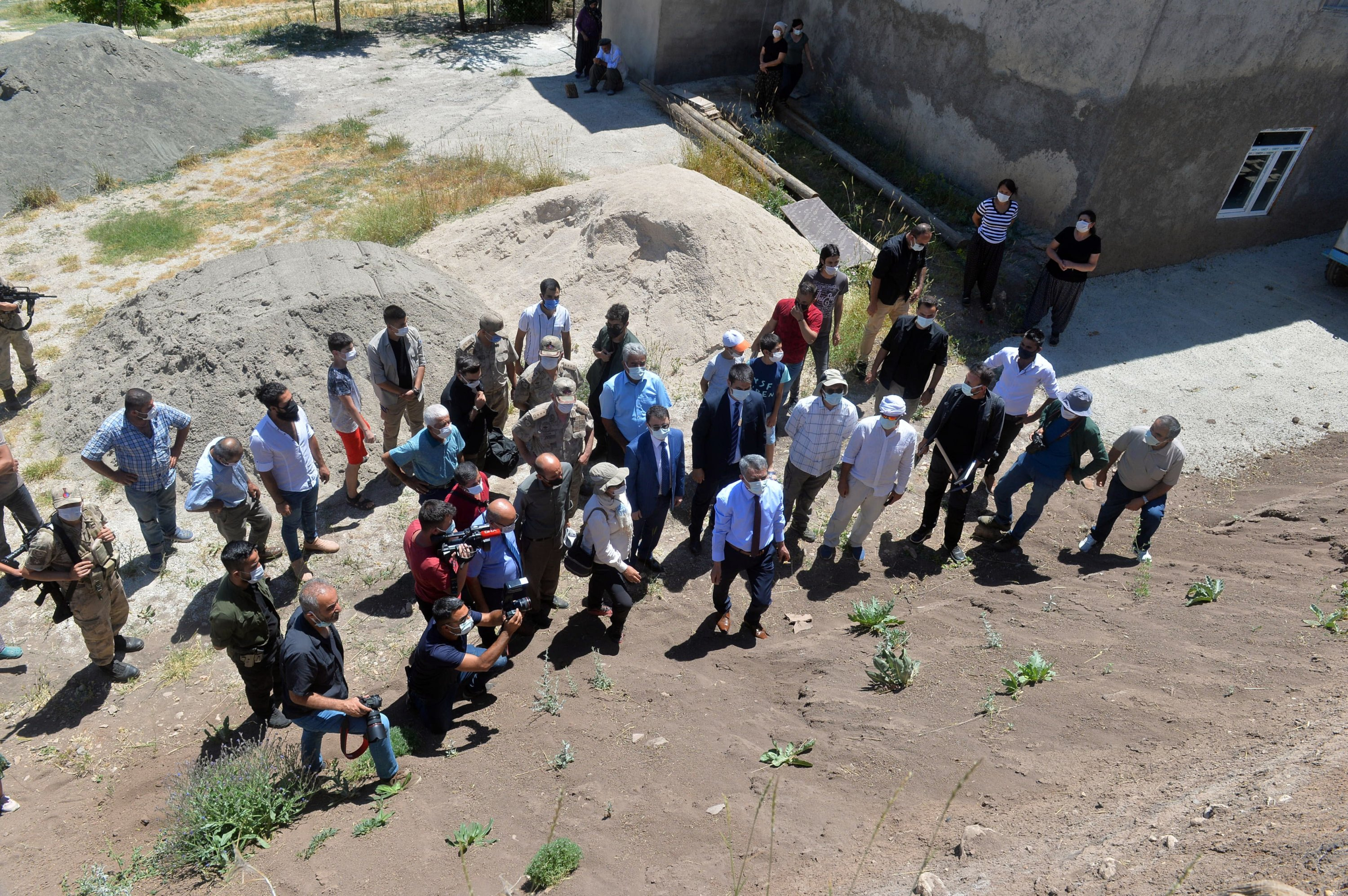 A group of archaeologists, academicians and authorities inspect the Tozkoparan Mound site in Tunceli, Turkey, June 22, 2021. (AA Photo)