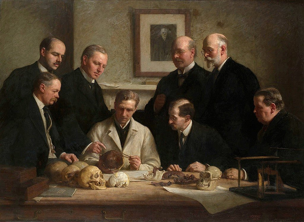 A painting by John Cooke shows the group portrait of the Piltdown skull's being examined.