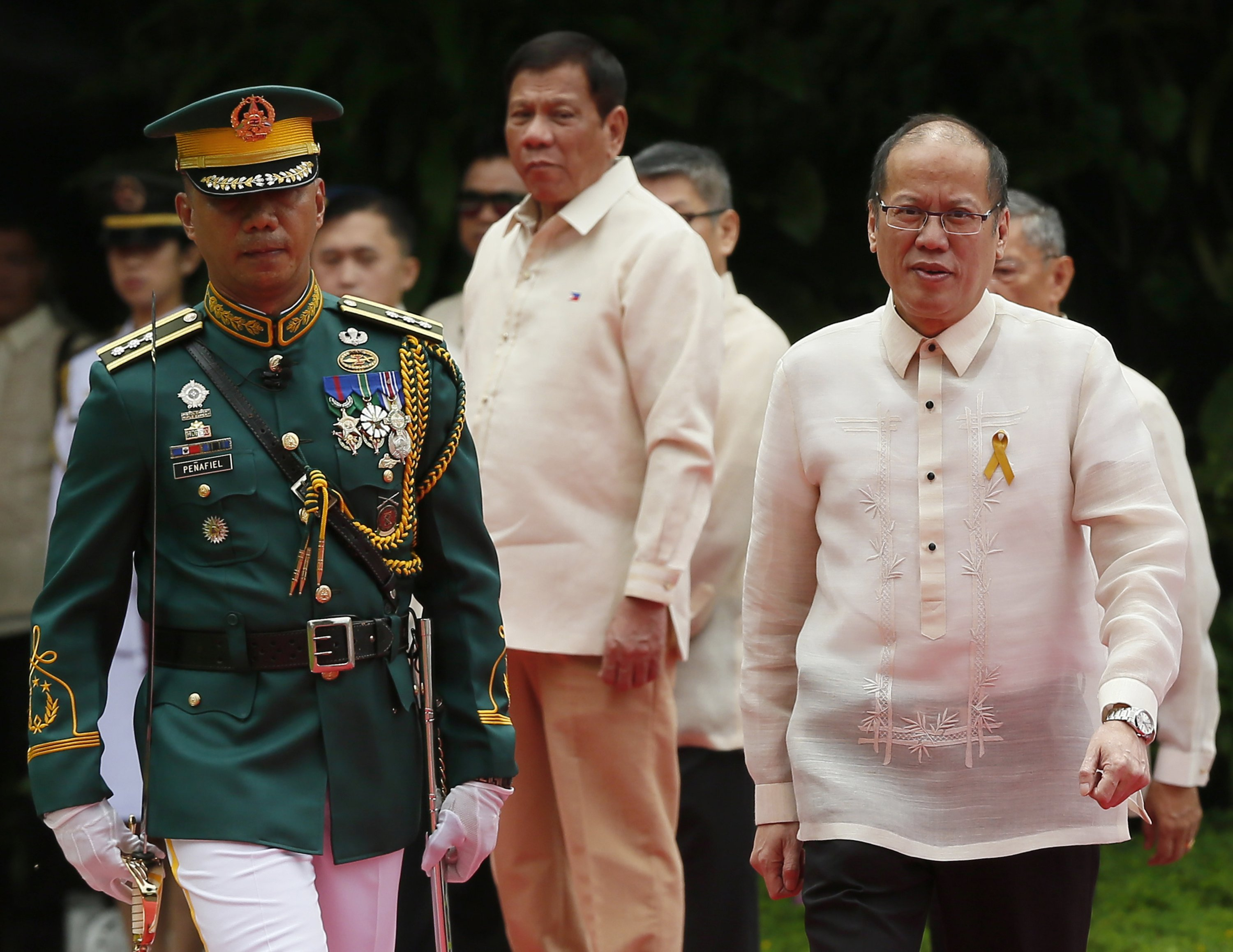 In this June 30, 2016, file photo, then outgoing President Benigno Aquino III (R) reviews the troops as new Philippine President Rodrigo Duterte (C) looks on during the inauguration ceremony, on the Malacanang Palace grounds in Manila, Philippines. (AP Photo)