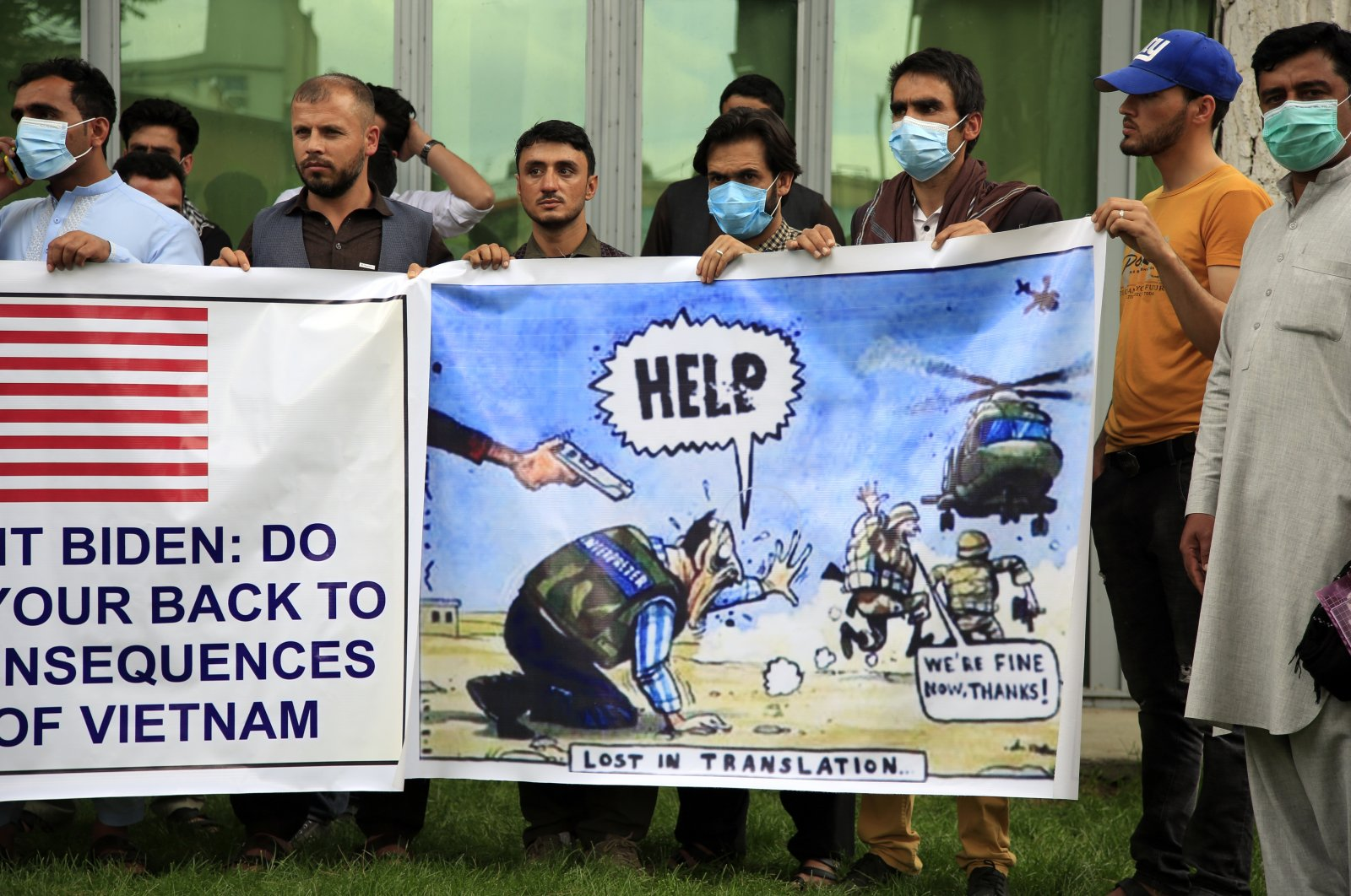 Afghan interpreters hold banners during a protest aimed at the U.S. government and NATO in Kabul, Afghanistan, April 30, 2021. (AP Photo)