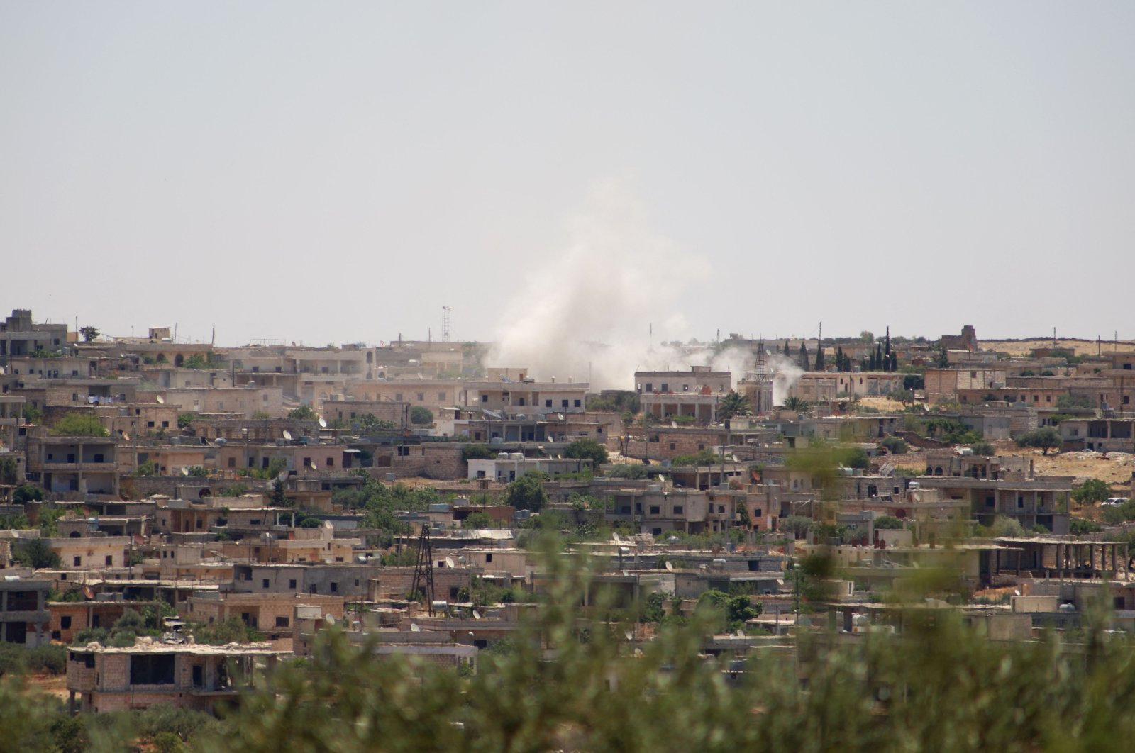 Smoke billows following reported bombardment by government forces in the town of Barah, in the Jabal al-Zawiya region of the opposition-held Idlib province, Syria, June 21, 2021. (AFP Photo)