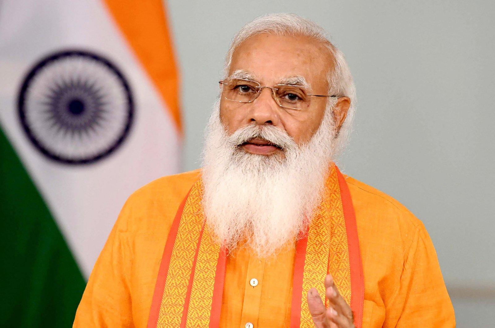 Indian Prime Minister Narendra Modi addressing the 7th International Yoga Day program, through video conferencing, in New Delhi, India, June 21, 2021. (Indian Press Information Bureau (PIB) via AFP)