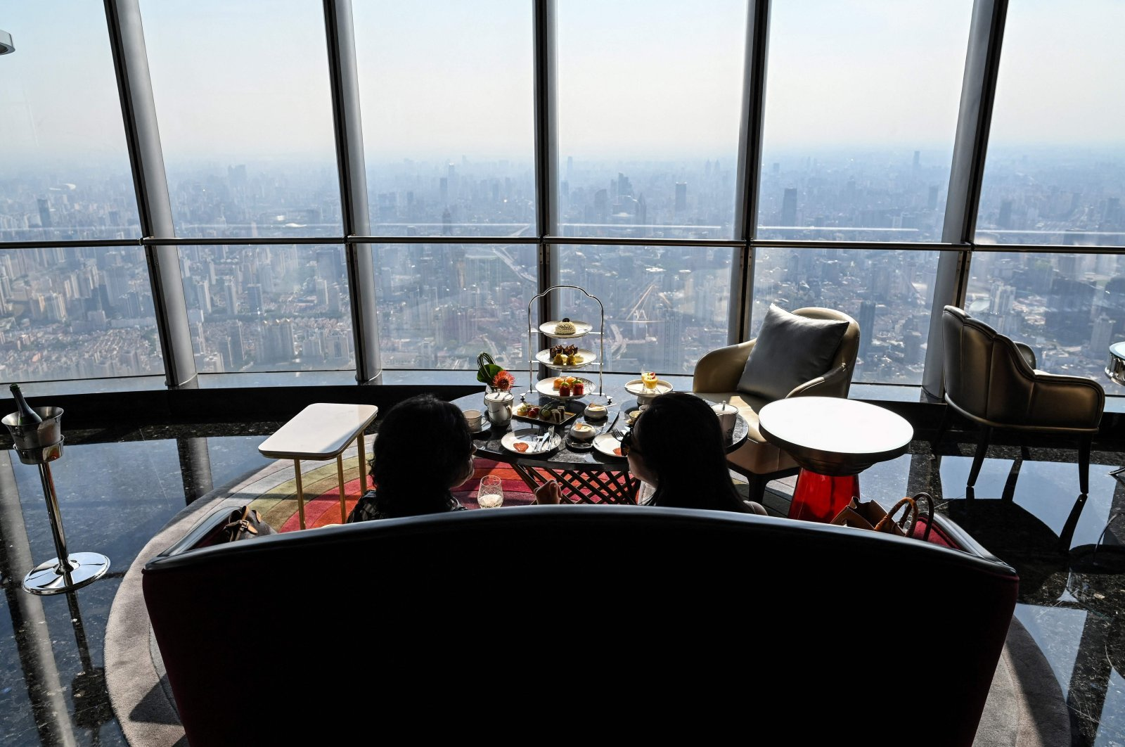 Guests are seen in the J Hotel, the world's highest luxury hotel, located in the Shanghai Tower, Shanghai, China, June 23, 2021. (AFP Photo)