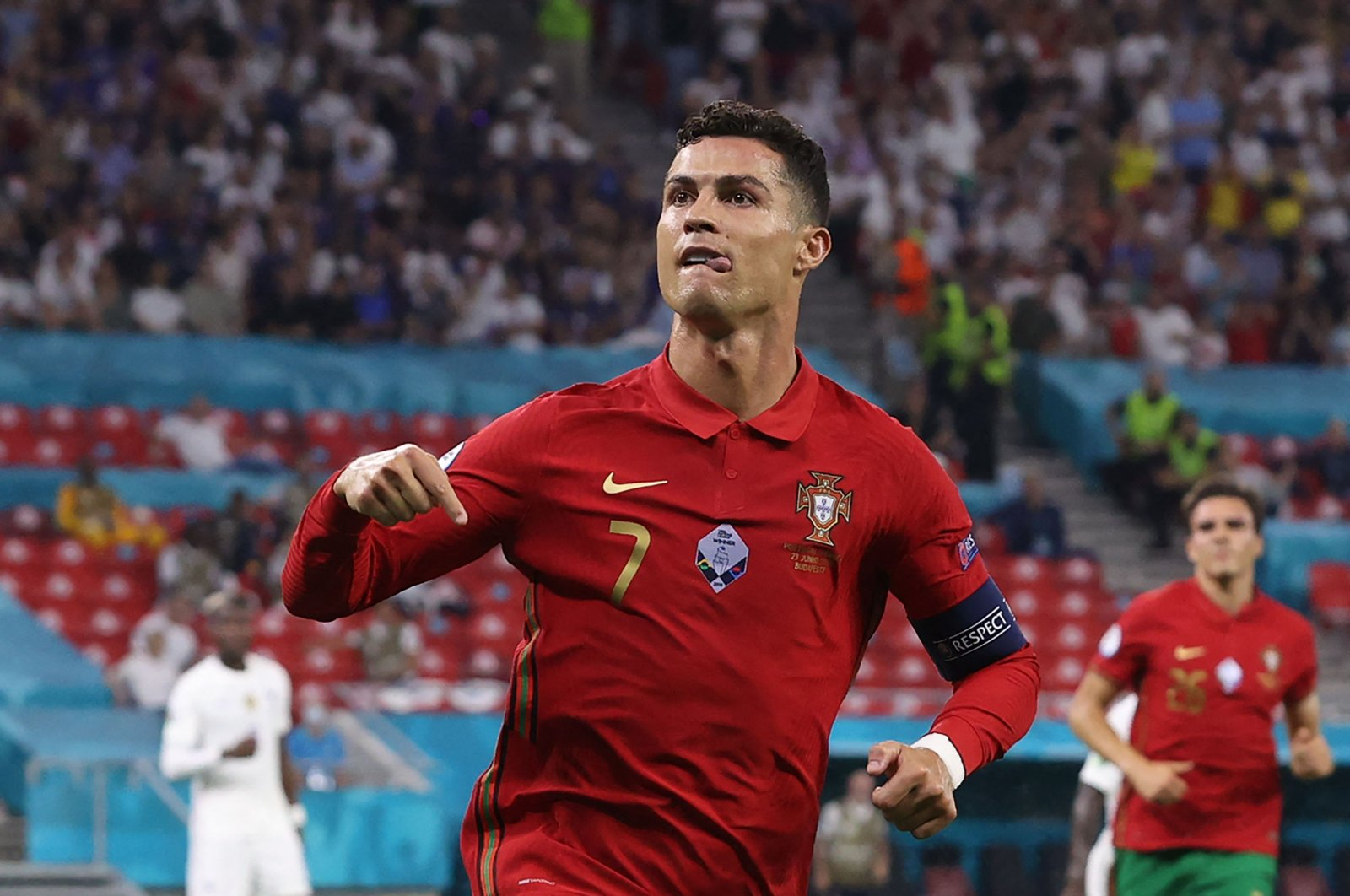Portugal forward Cristiano Ronaldo celebrates after scoring a second penalty during the UEFA Euro 2020 Group F match against France at Puskas Arena, Budapest, Hungary, June 23, 2021. (AFP Photo)